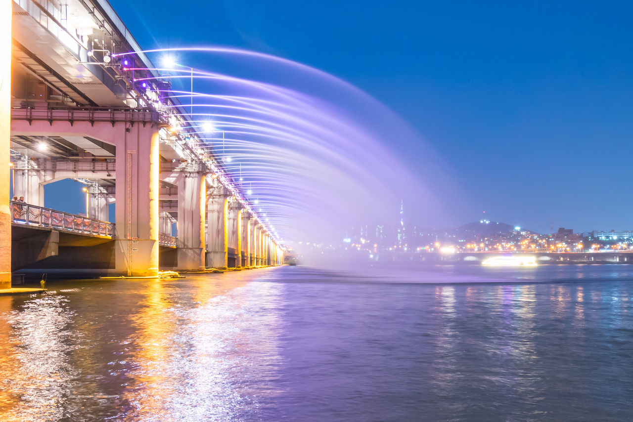 Rainbow Fountain Show at Banpo Bridge, Seoul Architecture Banpo Bridge Blue Built Structure Engineering Illuminated Nature No People Outdoors Rainbow Fountain Reflection Rippled Scenics Sky South Korea Tranquil Scene Tranquility Water Waterfront