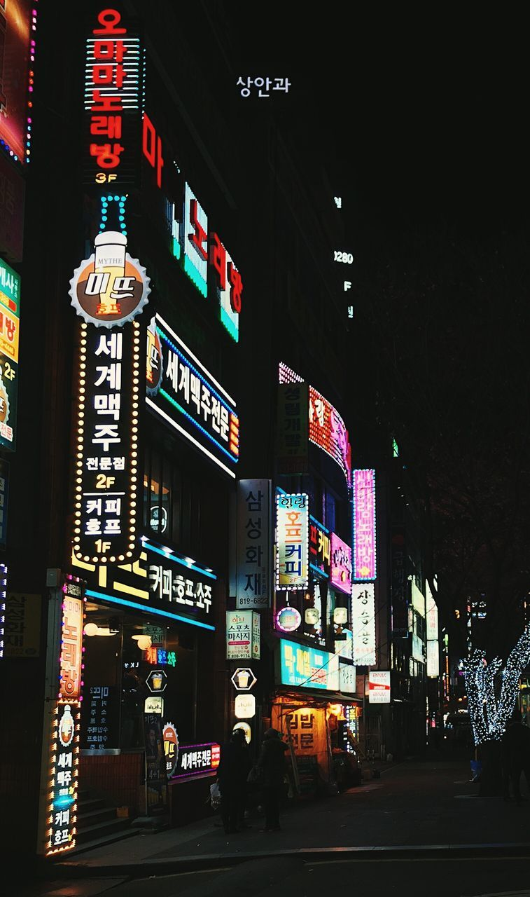 night, billboard, illuminated, advertisement, building exterior, architecture, text, communication, city, built structure, neon, travel destinations, real people, outdoors, modern, nightlife