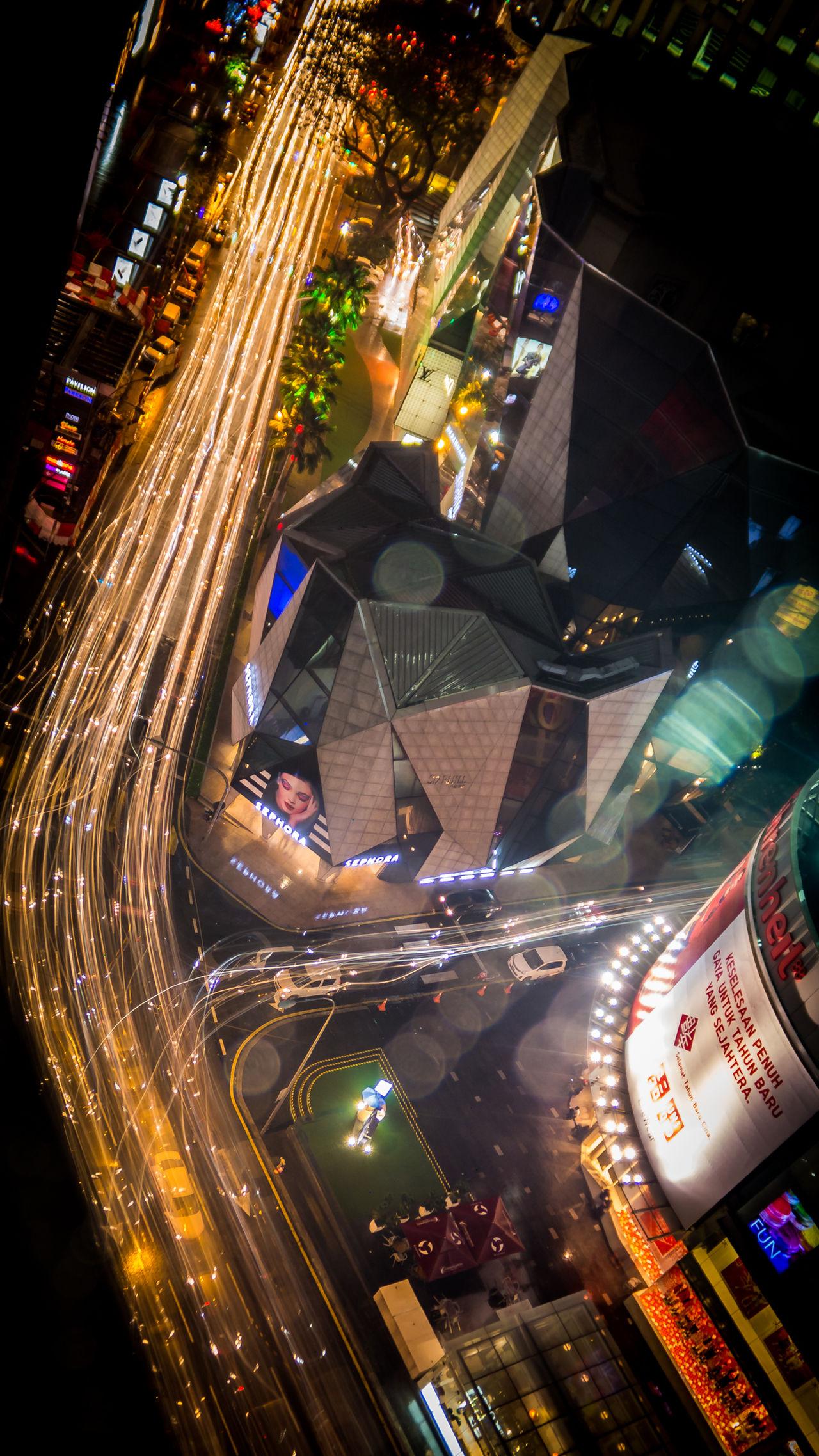 Cities At Night City City Life City Street Fiber Optics Ghosting Illuminated Light Thread Light Trail Long Exposure Modern Multi Colored Night No People Outdoors Road Tilt Traffic Travel Destinations