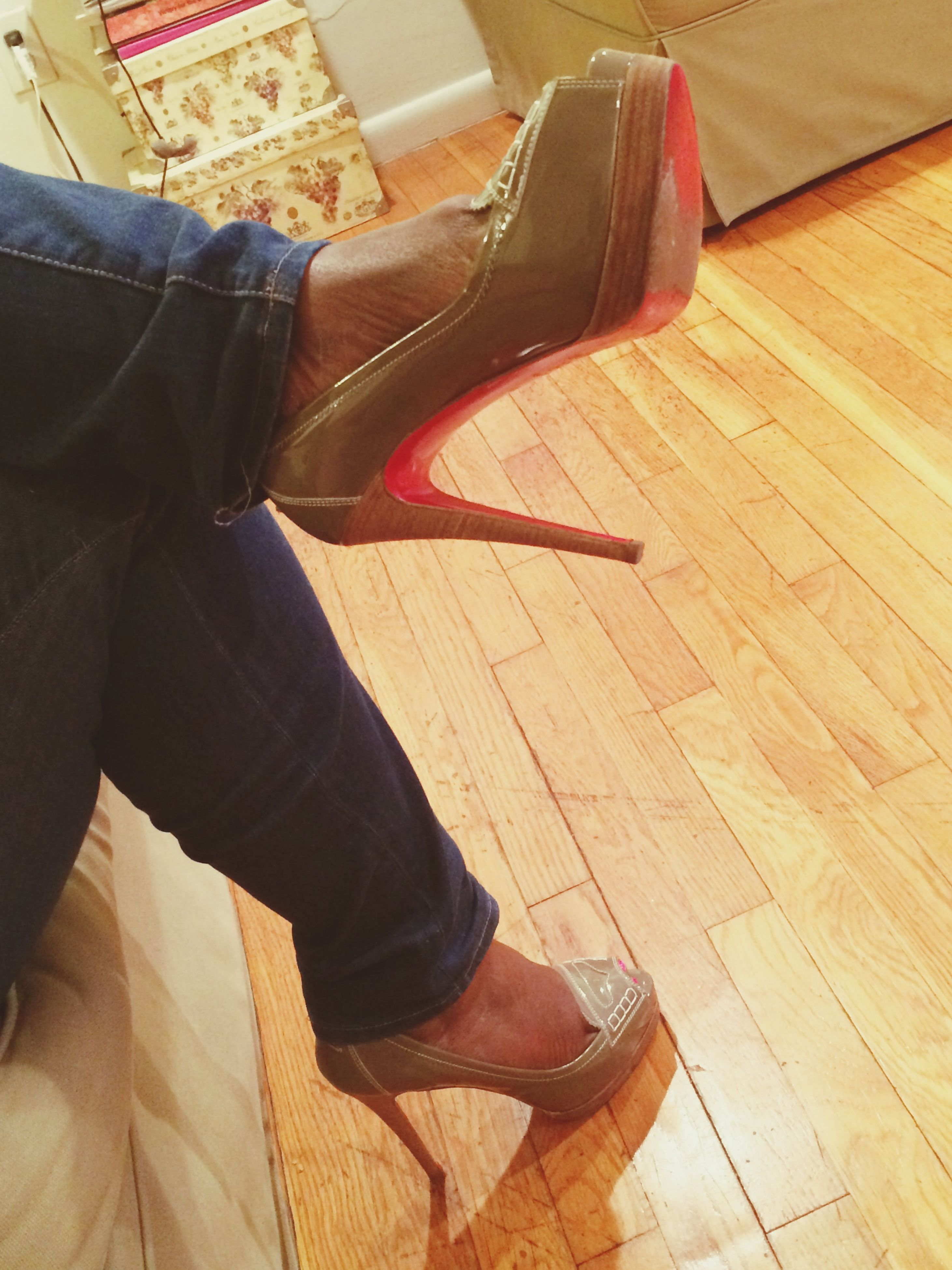 indoors, low section, person, shoe, high angle view, flooring, hardwood floor, lifestyles, relaxation, sitting, human foot, standing, footwear, wood - material, jeans, home interior, personal perspective, floor