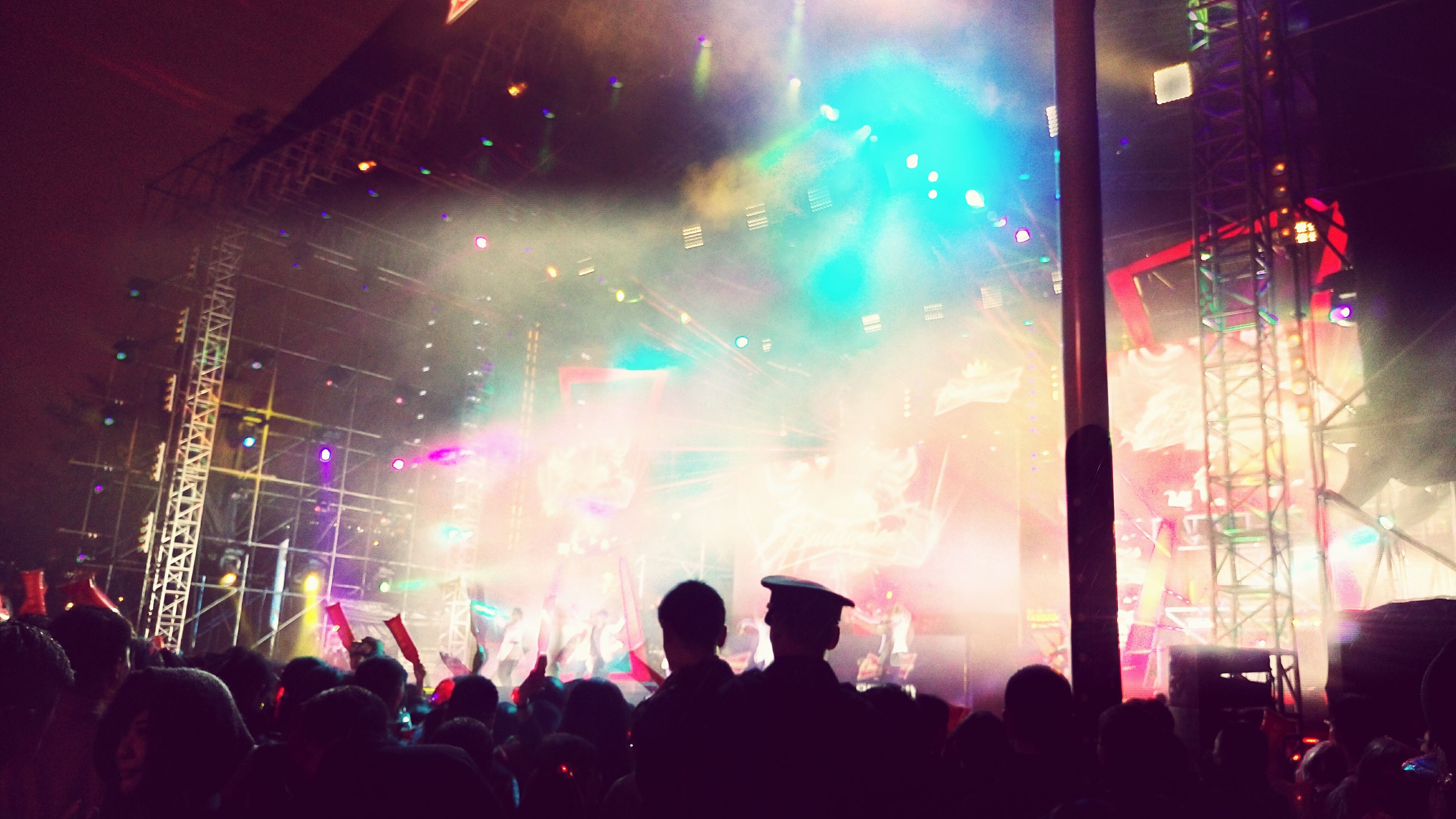 large group of people, crowd, illuminated, person, lifestyles, nightlife, music, enjoyment, arts culture and entertainment, event, men, night, leisure activity, performance, fun, popular music concert, music festival, stage light