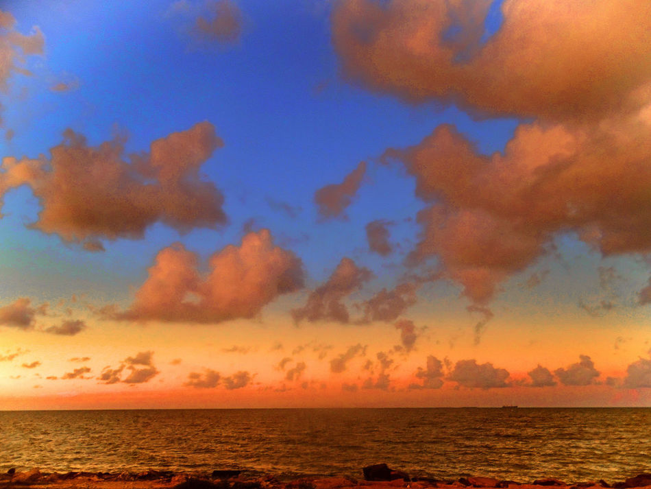 Atmosphere Atmospheric Mood Beach Beautiful Nature Beauty In Nature Cloud Cloud - Sky Cloudscape Dike Dusk Majestic Moody Sky Ocean Orange Color Outdoors Sky Sunset Texas Texas City Texas City Dike Tranquil Scene Tranquility