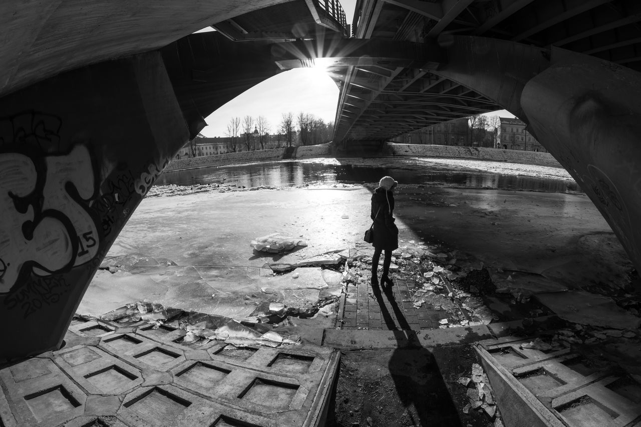 Architecture Bridge - Man Made Structure Built Structure City Cold Day Ice Lifestyles One Person Real People River Sun Sunset The City Light Water Winter