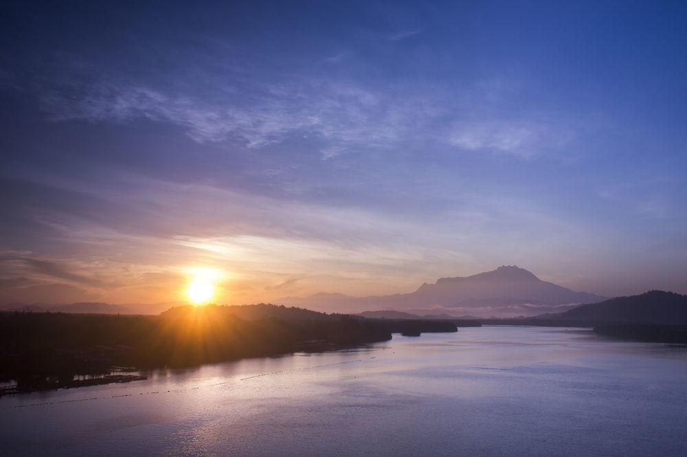 Mount Kinabalu sunrise from Mengkabong Bridge, Tuaran, Sabah, Malaysia Beauty In Nature Day Idyllic Lake Landscape Mengkabong Bridge Mengkabong River Mount Kinabalu Mountain Nature No People Outdoors Scenics Sky Sunrise Sunset Tranquil Scene Tranquility Tuaran Water Waterfront