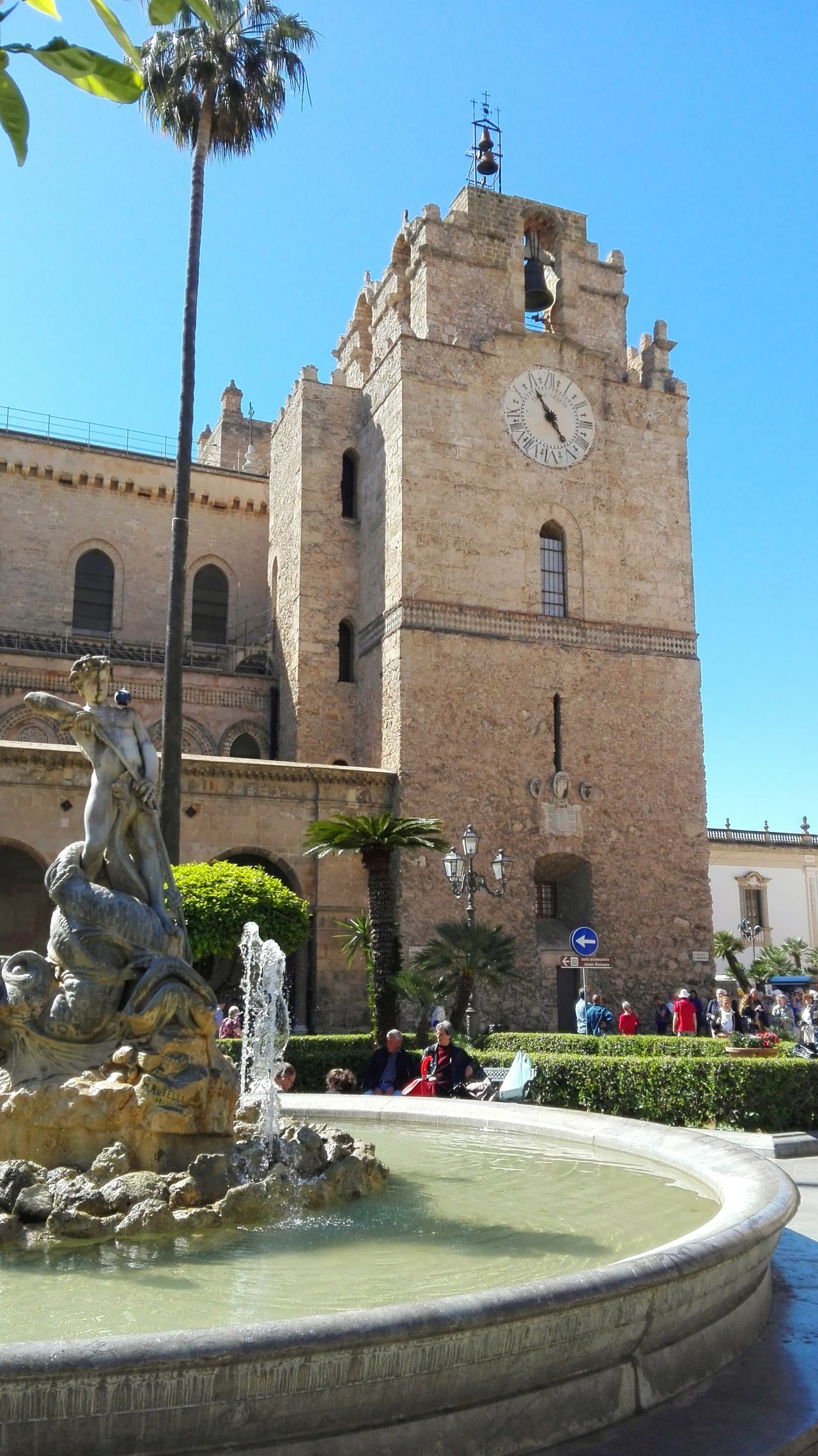 UNESCO World Heritage Site Architecture Fountain Building Exterior Built Structure History Water Statue Day Travel Destinations City No People Outdoors Sculpture Sky Clear Sky Tree Cityscape Clock Clock Face Monreale Cathedral Italy Palermo