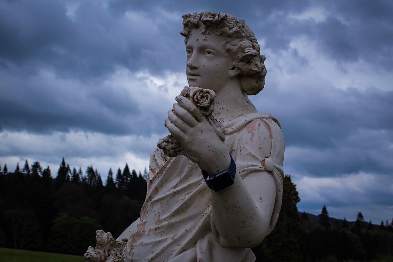 Statue with Apple Watch, Kilronan Castle, Co Rosscommon, Ireland, Statue Sculpture Cloud - Sky Human Representation Sky Male Likeness Art And Craft Female Likeness Low Angle View Outdoors No People Day Travel Destinations