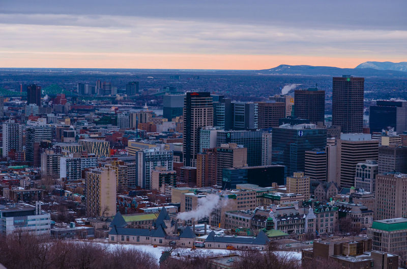 Montreal sunrise Cityscape City Business Finance And Industry Skyscraper Sky Building Exterior Travel Destinations Architecture Outdoors Social Issues Urban Skyline No People Sunset Modern Cloud - Sky Day Fresh On Eyeem  Eyeem Photography On Eyeem Nature Low Angle View Mont Royal Winter Cityfromabove Montreal Canada