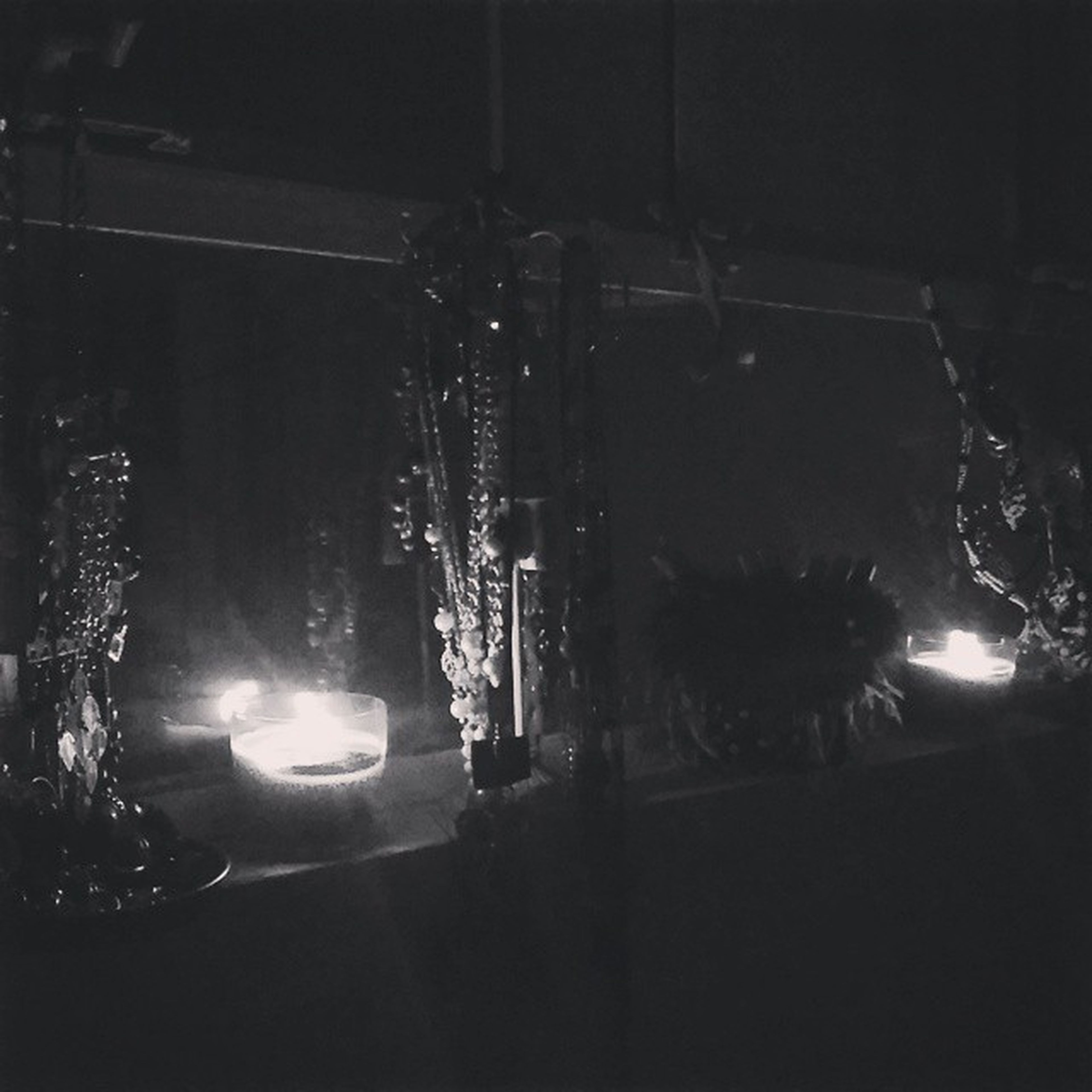 illuminated, night, lighting equipment, building exterior, street light, built structure, architecture, dark, street, light - natural phenomenon, glowing, city, road, outdoors, electricity, light beam, no people, sky, transportation, land vehicle