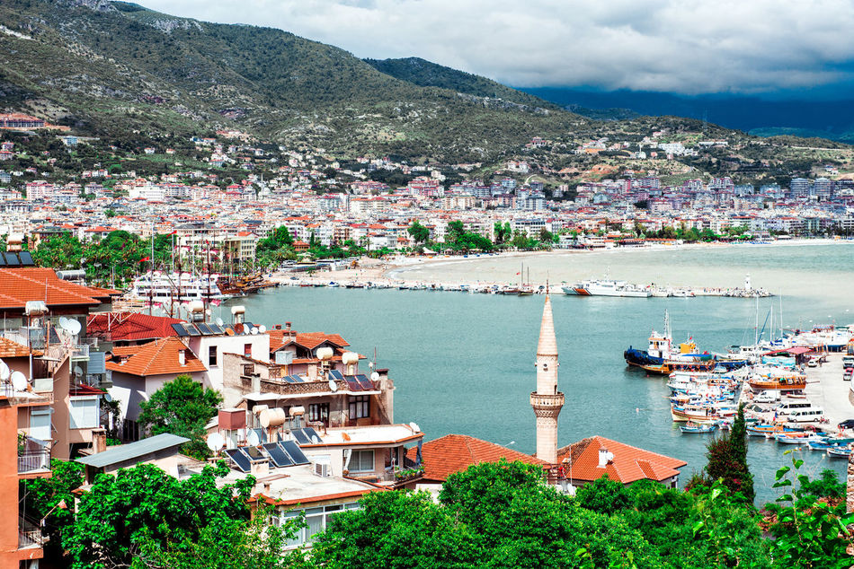 View from the old fortress to Alanya port. Turkey Alanya/Turkey ASIA Bay City Cloud - Sky Coastal Feature Harbor Landmark Landscape Mediterranean Sea Middle East Mountains Nature Outdoors Picturesque Port Sea Seaside Sky Sunny Day Tourist Resort Travel Destinations Tropical Climate Turkey Water