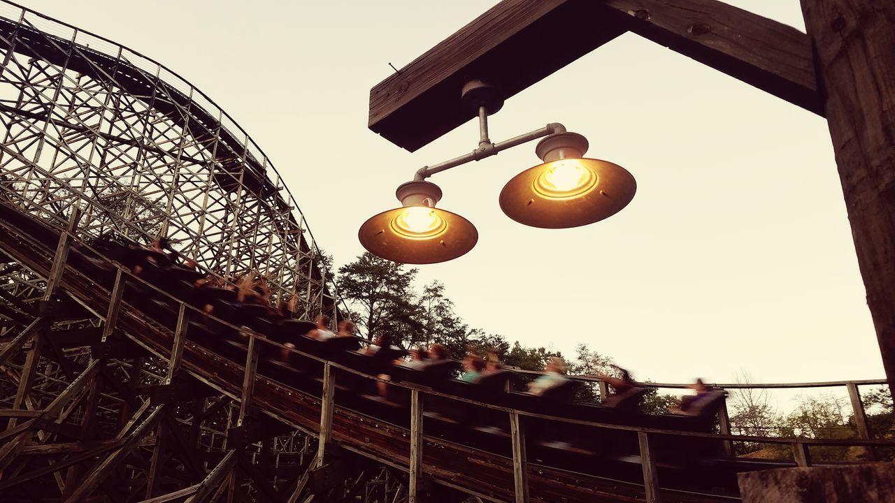 Thunderhead train at sunset Sunset Outdoors Sky Travel Amusement Park Theme Park Roller Coaster Ride Rollercoaster Thrill EyeEmNewHere Wood Wooden Dollywood Thunderhead Train Light Sepia GCII