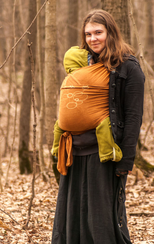 Bare branches above, fallen leaves under Autumn Baby Baby Sling Baby Wrap Babywearing Bonding Childhood Children Day Family Forest Happiness Leisure Activity Lifestyle Looking At Camera Love Maternity Mom Mother And Son Motherhood Outdoors Parenting Sling Smiling Woman