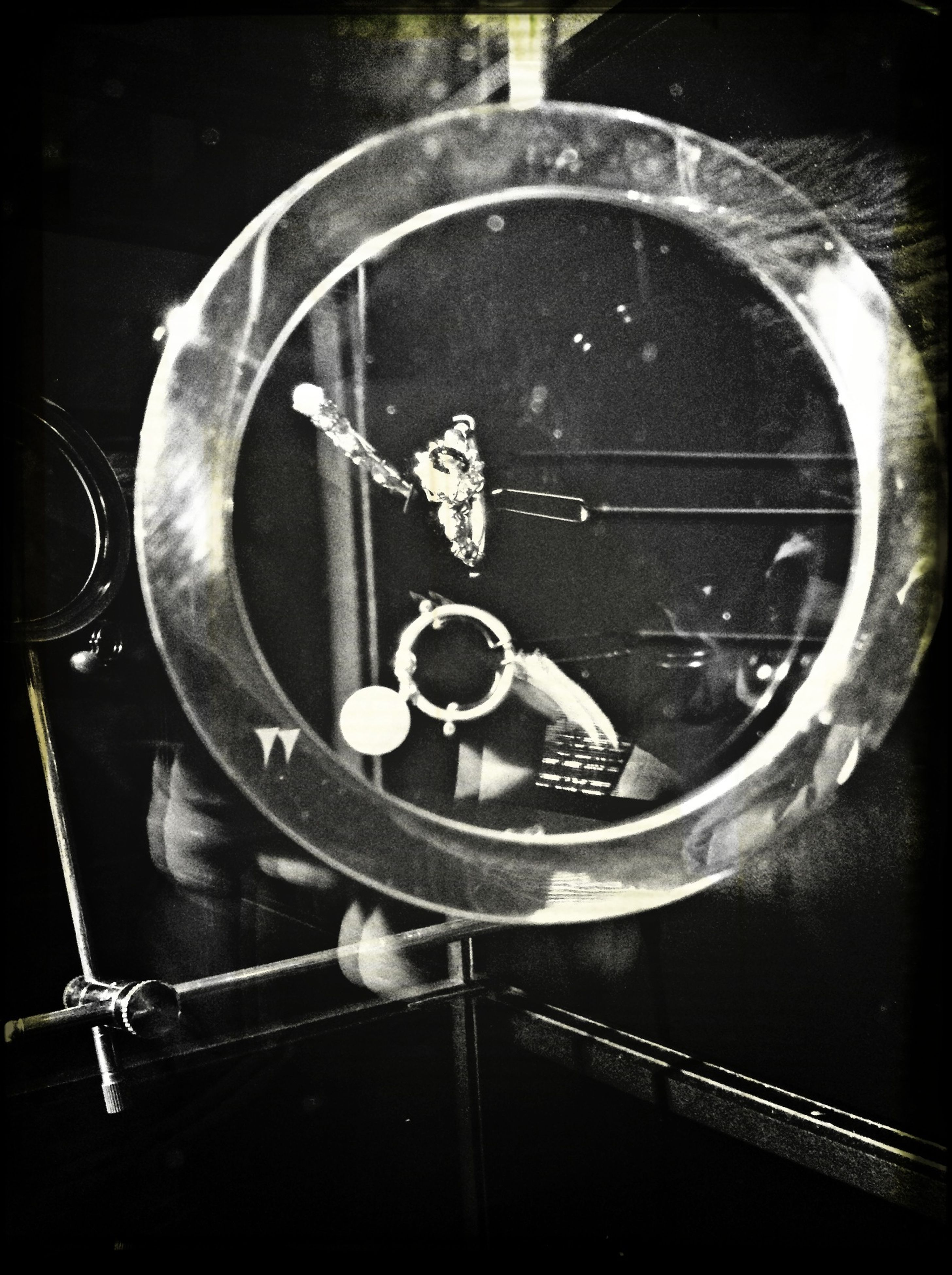 metal, high angle view, indoors, close-up, equipment, part of, one person, auto post production filter, holding, transfer print, cropped, circle, day, industry, preparation, music, directly above, spoon, metallic