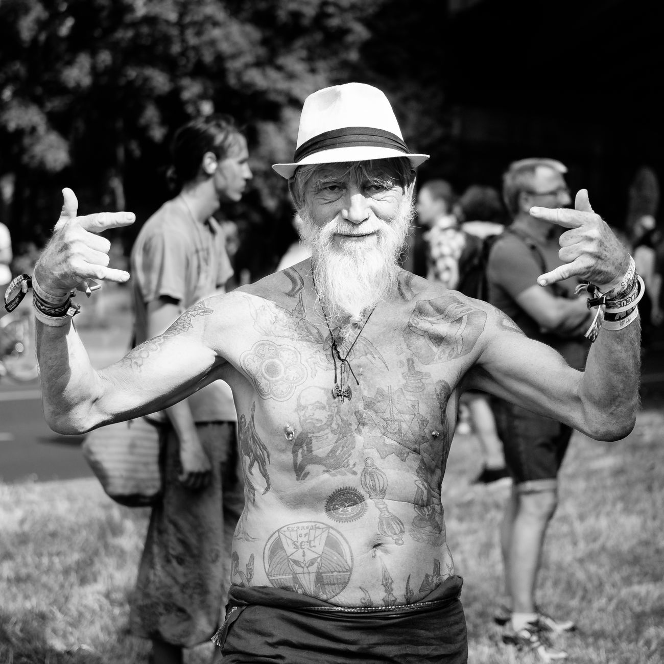 Portrait of 'Gandalf', taken at the 'Zug der Liebe' in Berlin. Battle Of The Cities Beard Black And White Blackandwhite Bw Cool Happiness Hat Old Old Man People People Photography Person Portrait Portrait Photography Street Street Photography Street Portrait Streetphoto_bw Streetphotography Tattoo Tattooed Tattoomodels Tattoos Zug Der Liebe