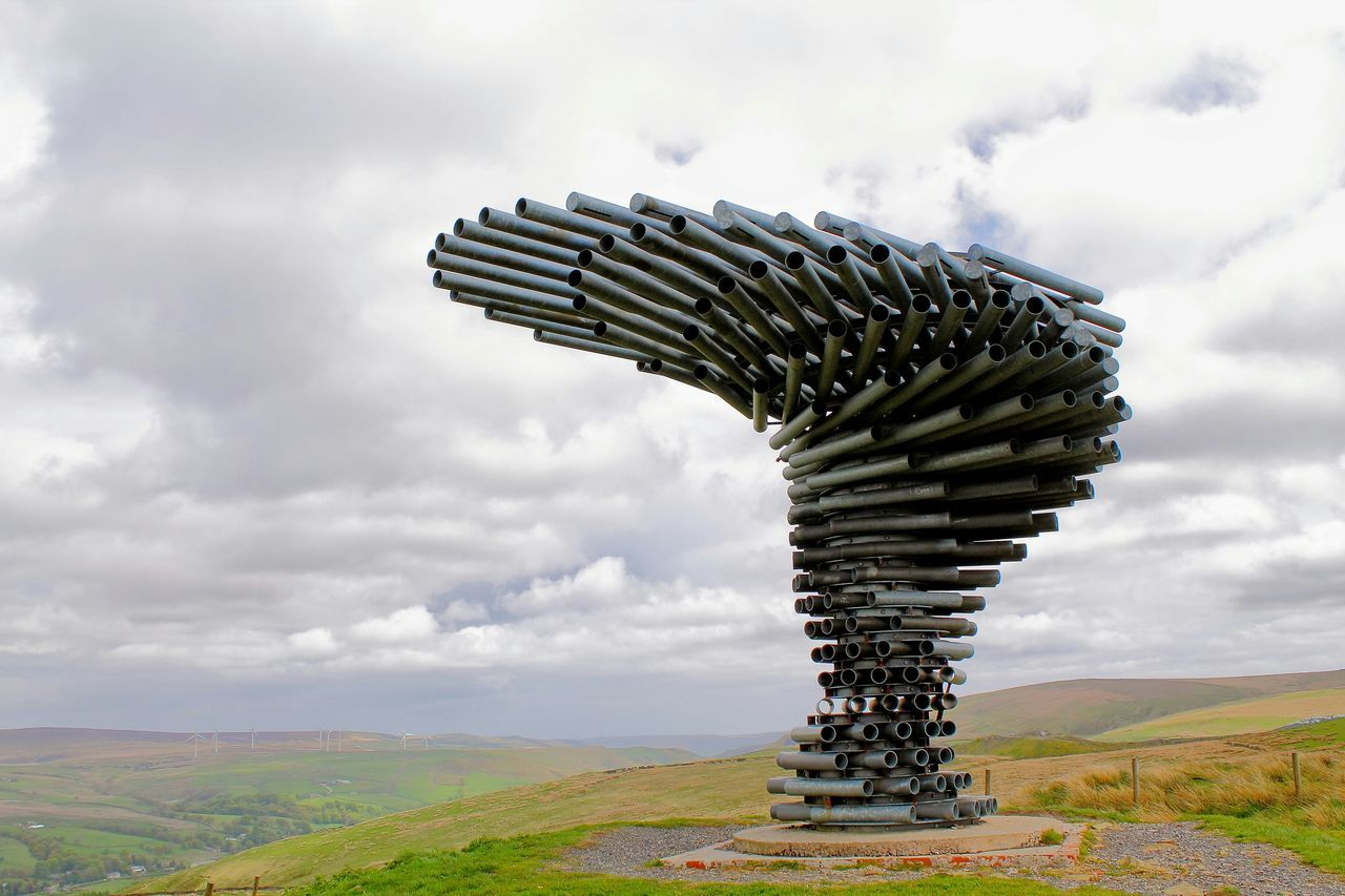 Singing Ringing Tree On Hill Against Cloudy Sky