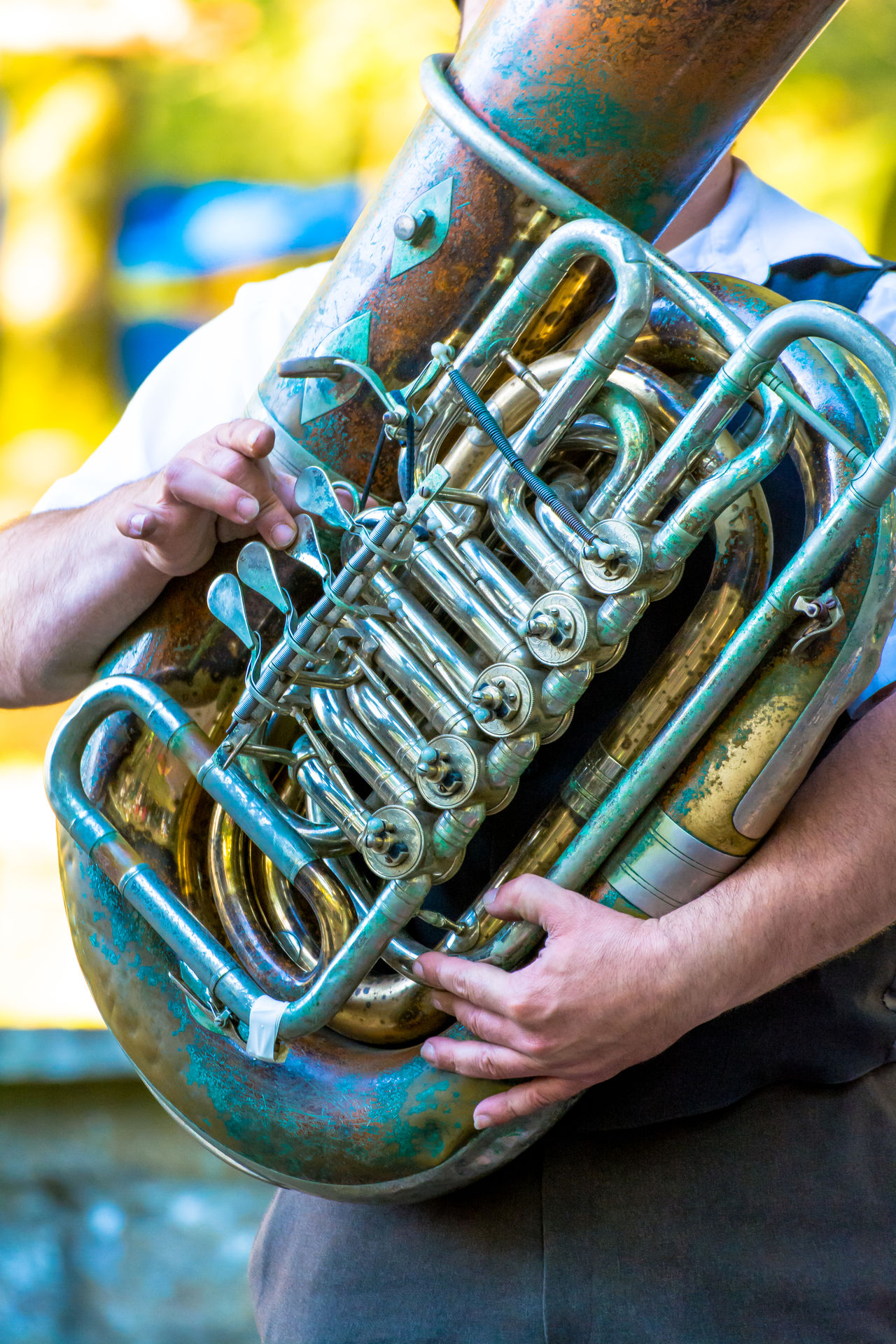 Close-up Concert Concert Photography Cropped Day Focus On Foreground Forest Holding Human Finger Leisure Activity Lifestyles Live Music Machinery Metallic Music Musical Instruments Musician Outdoors Part Of Person Selective Focus Skill  Tuba Unrecognizable Person Work Tool