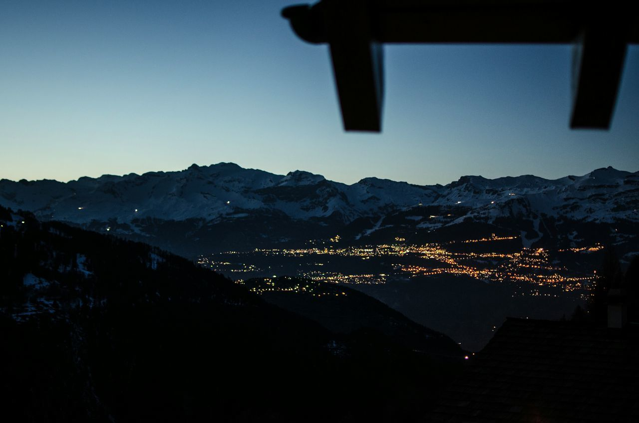 Somewhere in the Swiss mountain from a wooden chalet Mountain Sky Night Lights Switzerland Alps City In The Night Chalet View