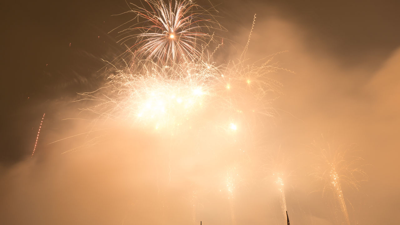 firework display, celebration, firework - man made object, night, glowing, exploding, long exposure, low angle view, no people, arts culture and entertainment, event, illuminated, outdoors, motion, firework, sky, close-up