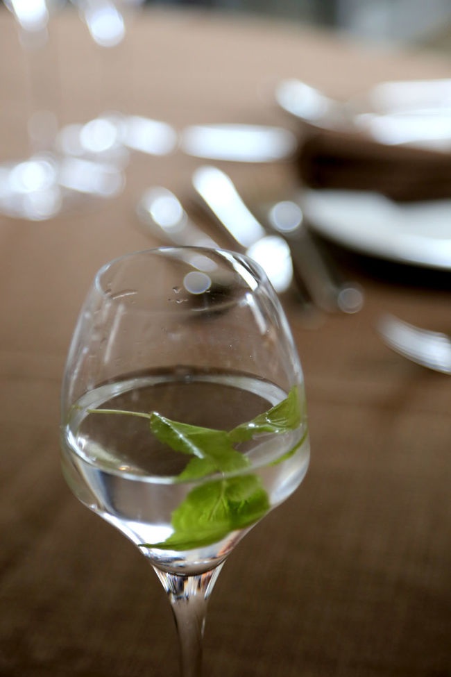 wining and dining, glas of lemon water in a posh restaurant Brown Table Cutlery Drinking Glass Focus On Foreground Freshness Hochzeitsfotografie Indulgence Lemon Water Marriage  No People Peppermint Leaf Posh Posh Restaurant Recommendation Refreshment Selective Focus Serving Size Still Life Upper Class Wedding Dinner Wining And Dining