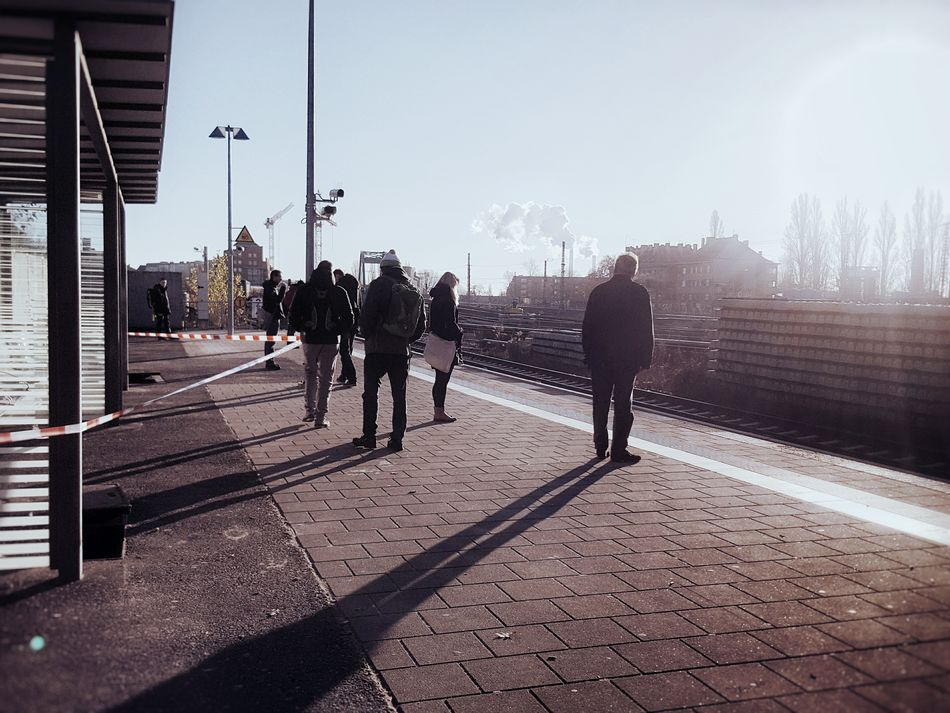 Long shadows... Adult Adults Only People Men City Outdoors Large Group Of People Only Men Day Sky Public Transportation Capture Berlin Sunlight And Shadow Streetphotography Urban Lifestyle Train Station Platform Commuter Life Commuters View Daily Commute My Year My View The City Light