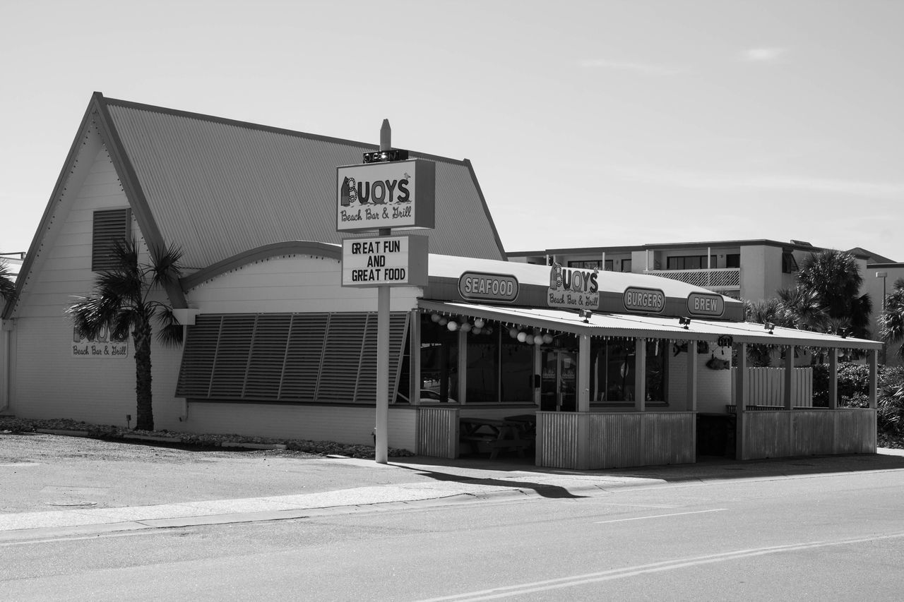 Boarded up water town Built Structure Building Exterior Outdoors Sky Day No People Text Architecture Black & White Blackandwhite Beach North Myrtle Beach South Carolina