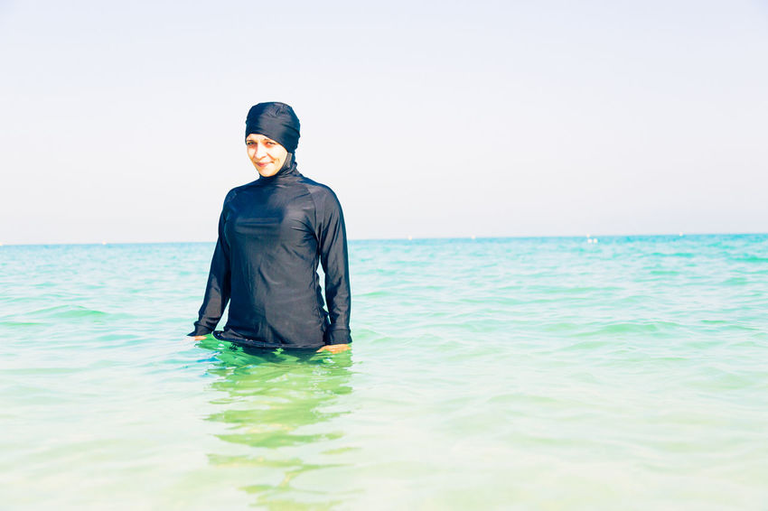Beach Life Burkini Dubai Fashion Muslim Culture Muslim Woman Arab Arabia Arabic Arabic Style Beach Burka  Controversial Day Headcover Muslim Nature One Person Outdoors Real People Swimwear Women