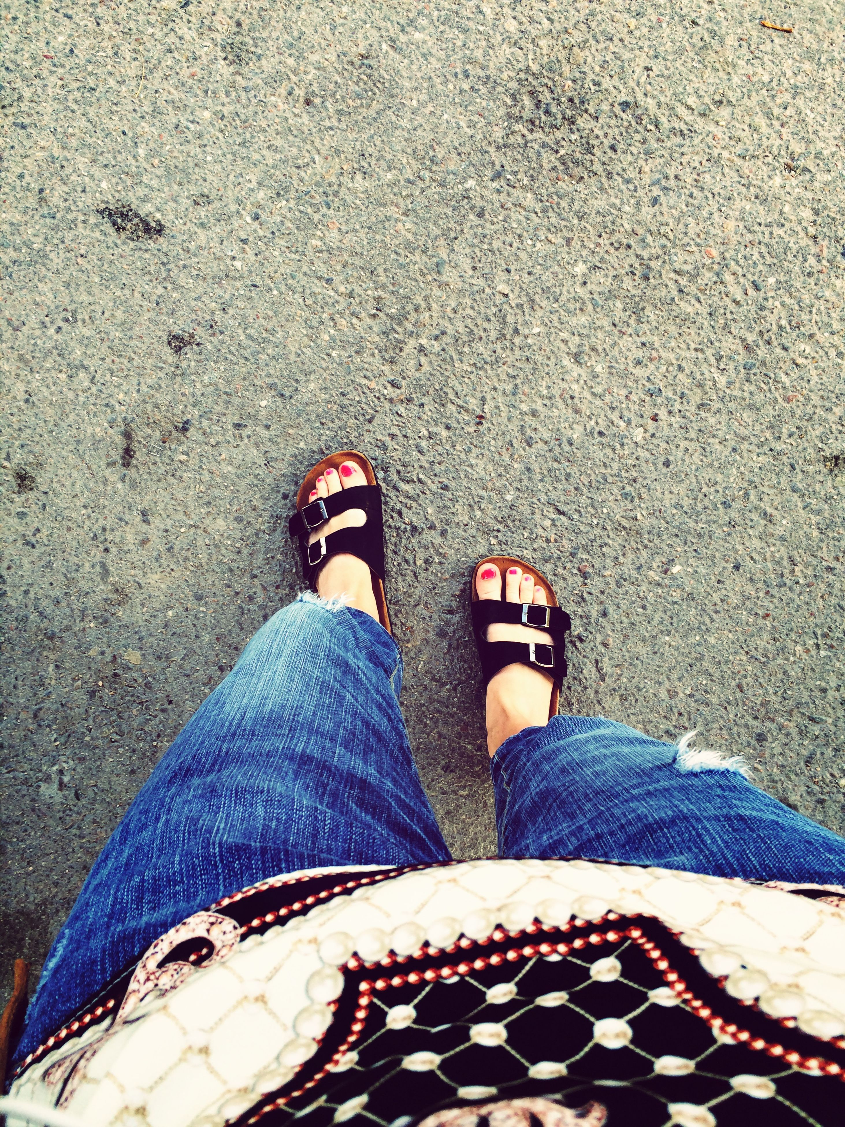 low section, person, shoe, personal perspective, human foot, footwear, high angle view, lifestyles, standing, jeans, leisure activity, relaxation, casual clothing, outdoors, day, street