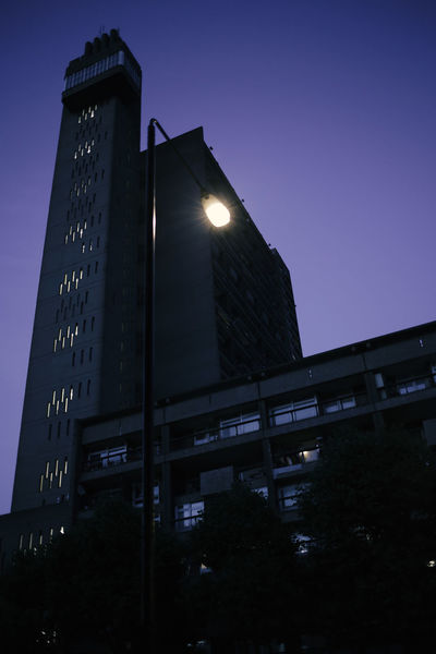 Trellick Tower London Architecture Building Exterior Built Structure Clear Sky Goldfinger Illuminated Illumination Low Angle View Night No People Outdoors Sky Skyscraper Street Trellick Tower Postcode Postcards