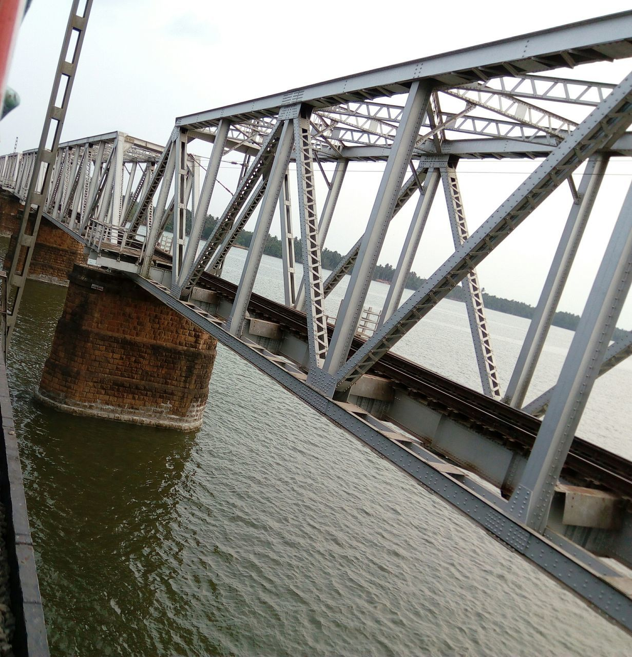 bridge - man made structure, connection, engineering, built structure, architecture, river, water, transportation, low angle view, day, outdoors, no people, bridge, sky