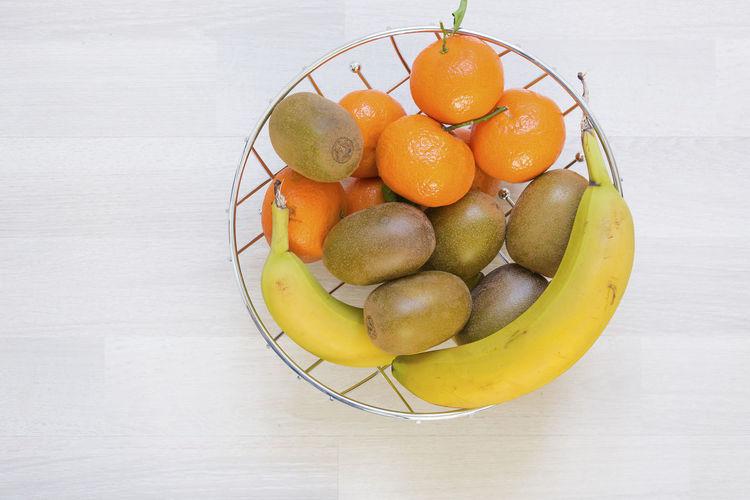 Aerial View Banana Basket Bowl Citrus Fruit Close-up Food Food And Drink Freshness Fruit Fruit Bowl Healthy Eating Indoors  Kiwi Mandarines No People Orange - Fruit Studio Shot White Background Whole