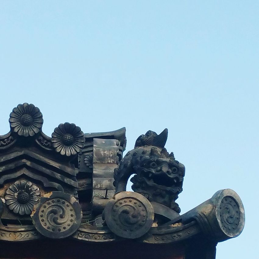Japanese Holiday some awesome roof tile detail on a really old temple in Japan.