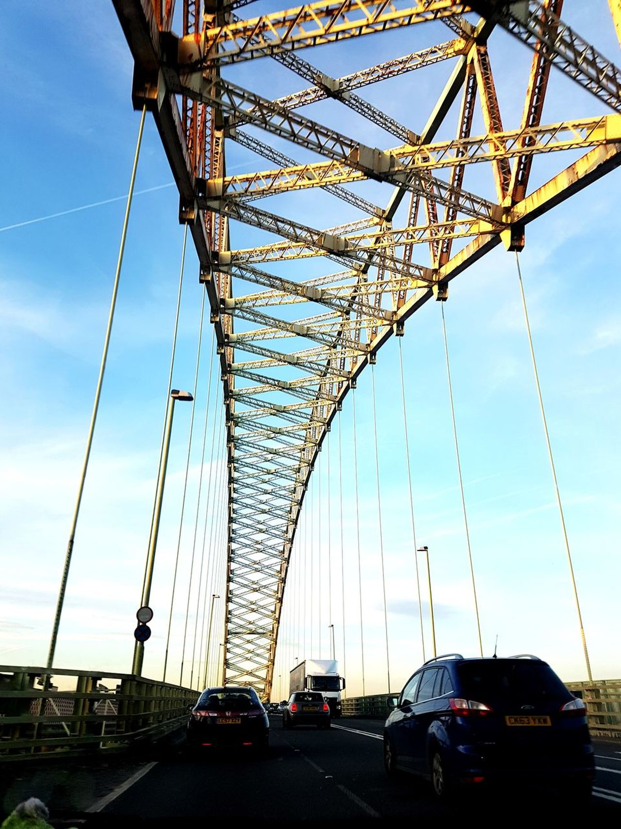 Bridge - Man Made Structure Transportation City Sky Outdoors Travel Destinations Architecture Suspension Bridge No People Vehicles Driving Vehicles On Road The Way Foward Low Angle View Backgrounds Metallic Structure Everyday Moments Everydayphotography Real Lives