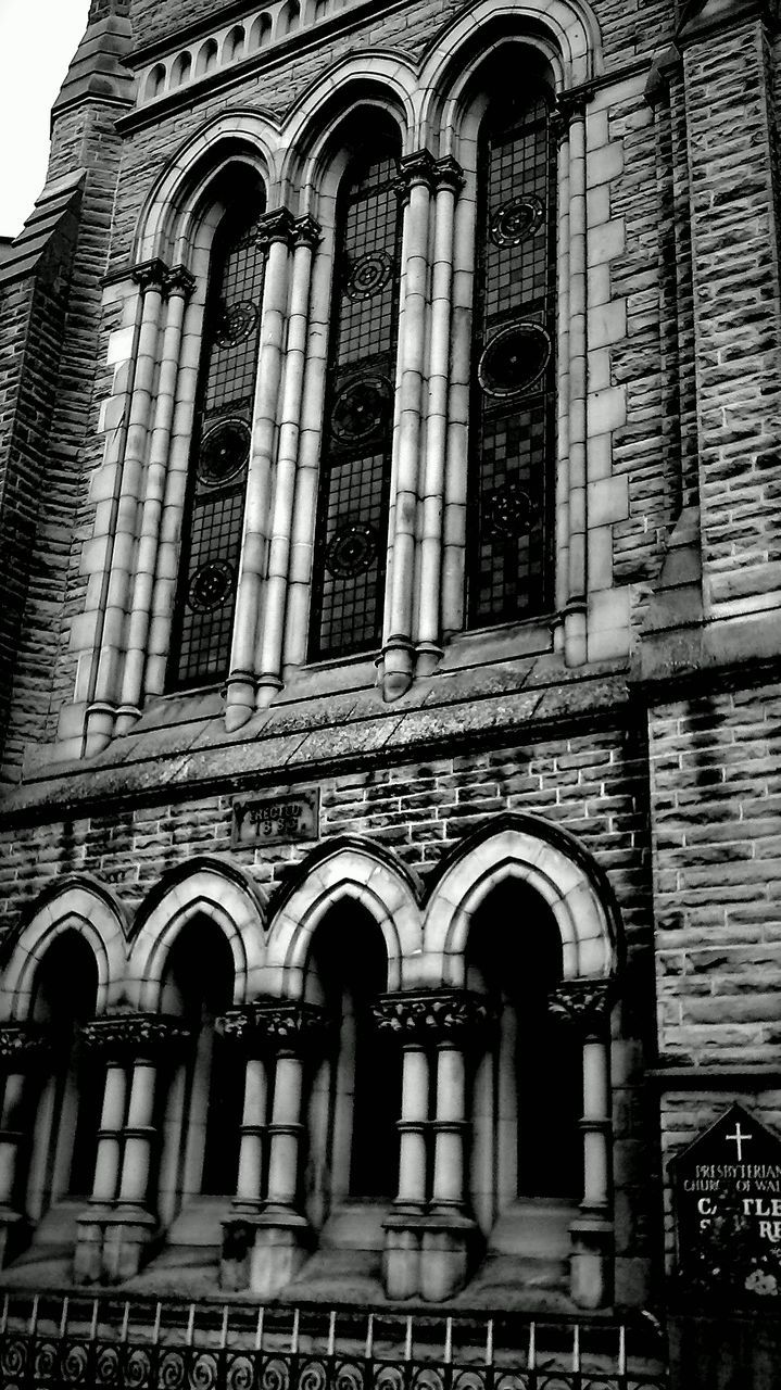 architecture, arch, low angle view, building exterior, built structure, religion, outdoors, spirituality, place of worship, day, no people