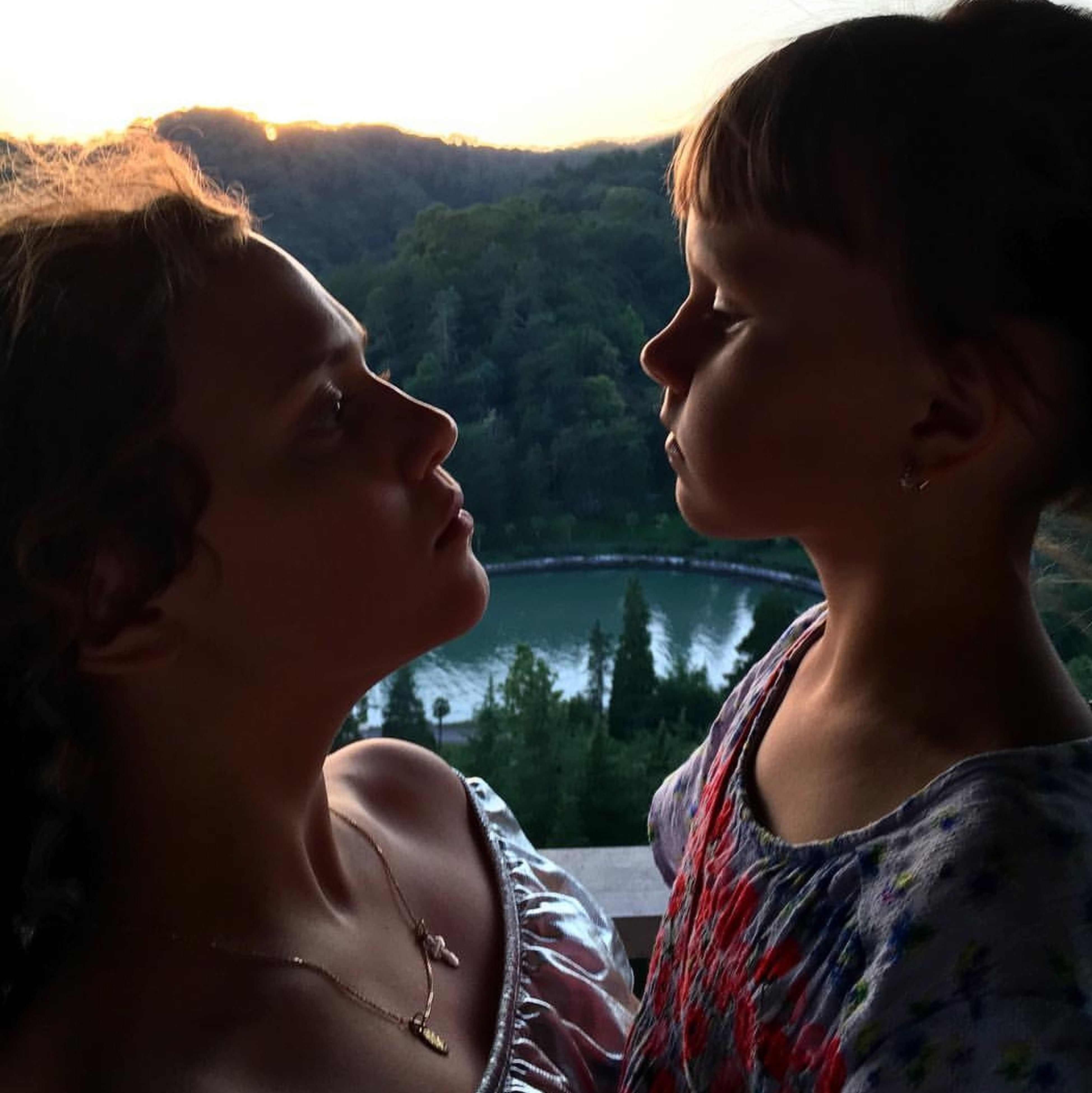 two people, togetherness, real people, love, mountain, young adult, young women, leisure activity, bonding, lifestyles, headshot, side view, beauty in nature, nature, outdoors, day, happiness, beautiful woman, tree, smiling, friendship, water, close-up, sky, adult, people