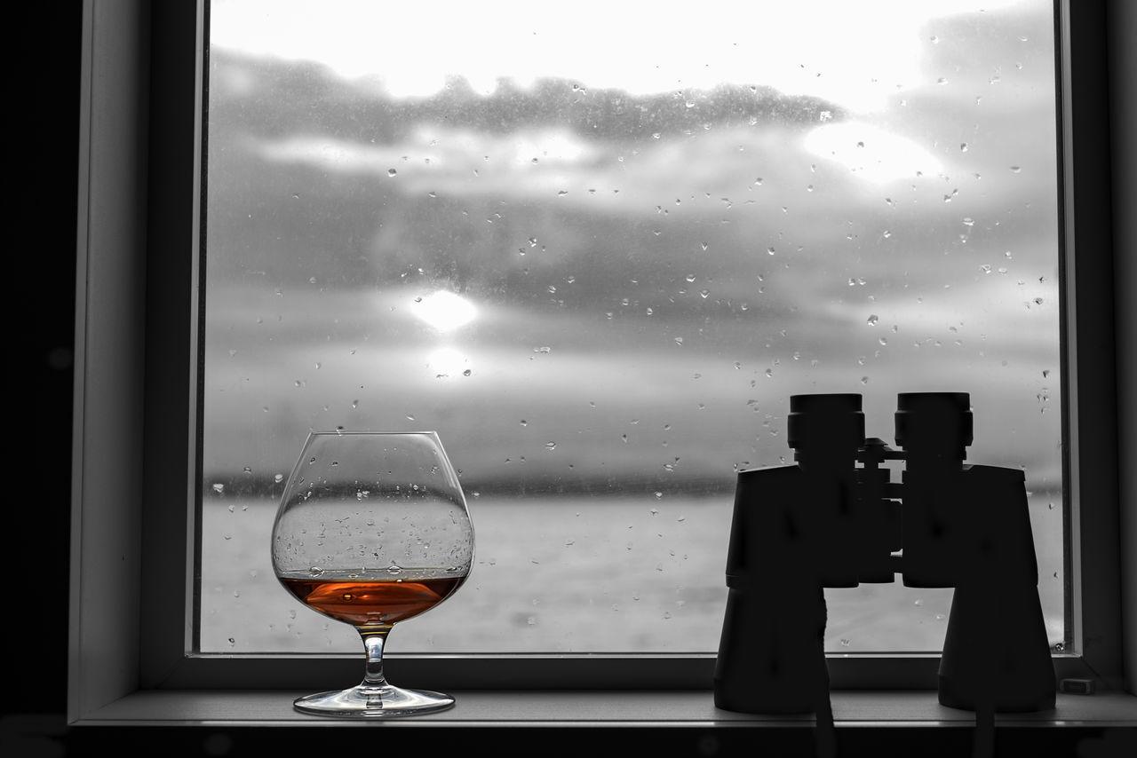 Brandy and binoculars on seaside window sea view Alcohol Beach Binoculars Brandy Close-up Cloudy Coast, Sand Cognac Dark Day Daylight Drink Glass Gray Masculine Scotch Shore Silhouette Sky Snifter Swirl Tasting Watching Whale Whiskey