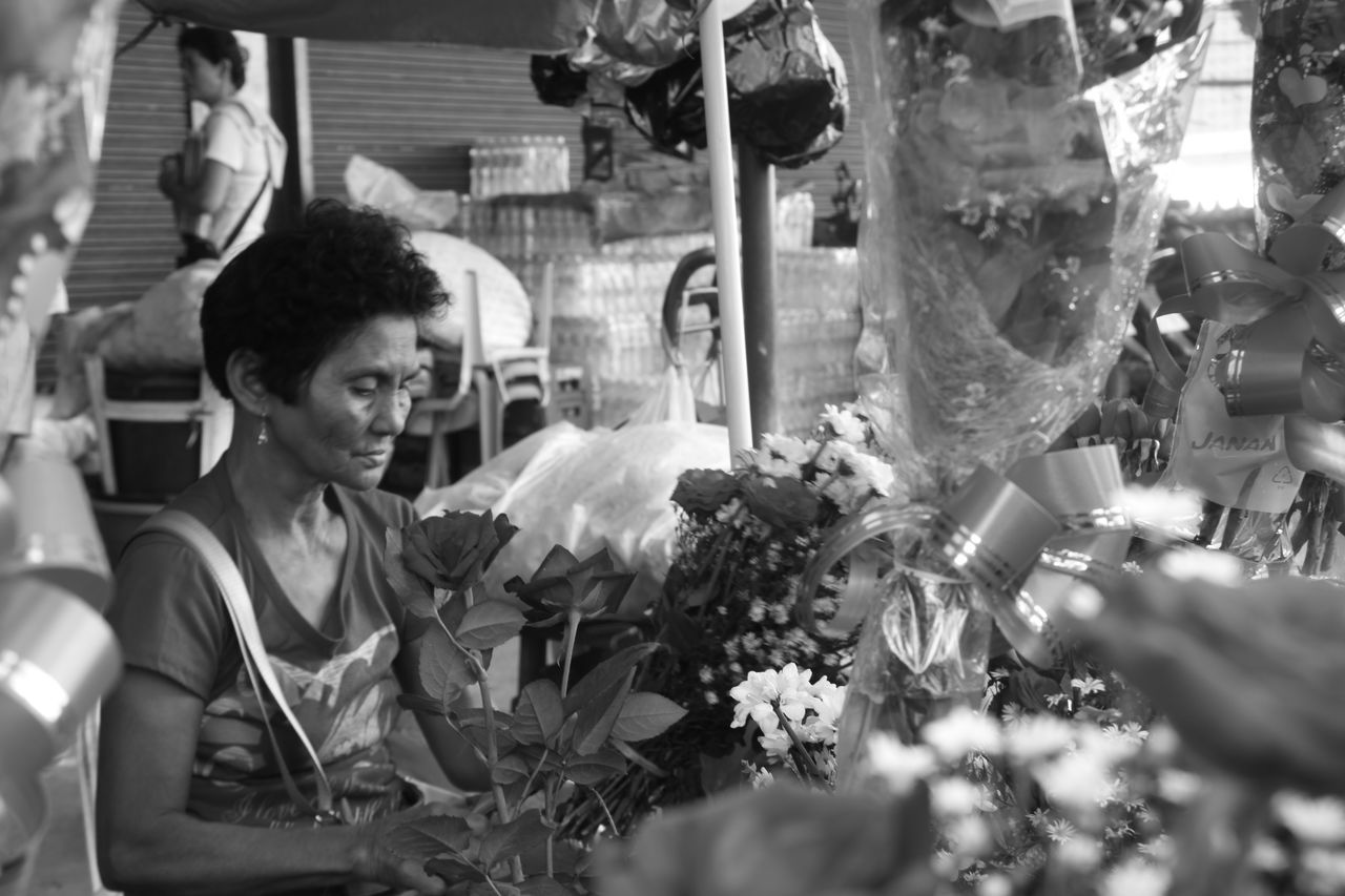 Black And White Photography Black And White Universe Casual Clothing Day Florsits Leisure Activity Lifestyles Market Old Lady Fixing Flowers Outdoors Portrait