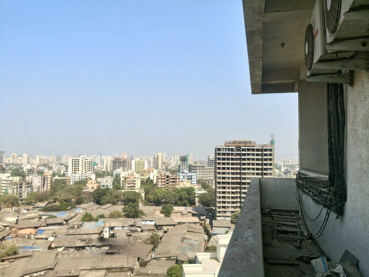 High Angle View Of Slum And City Against Clear Sky