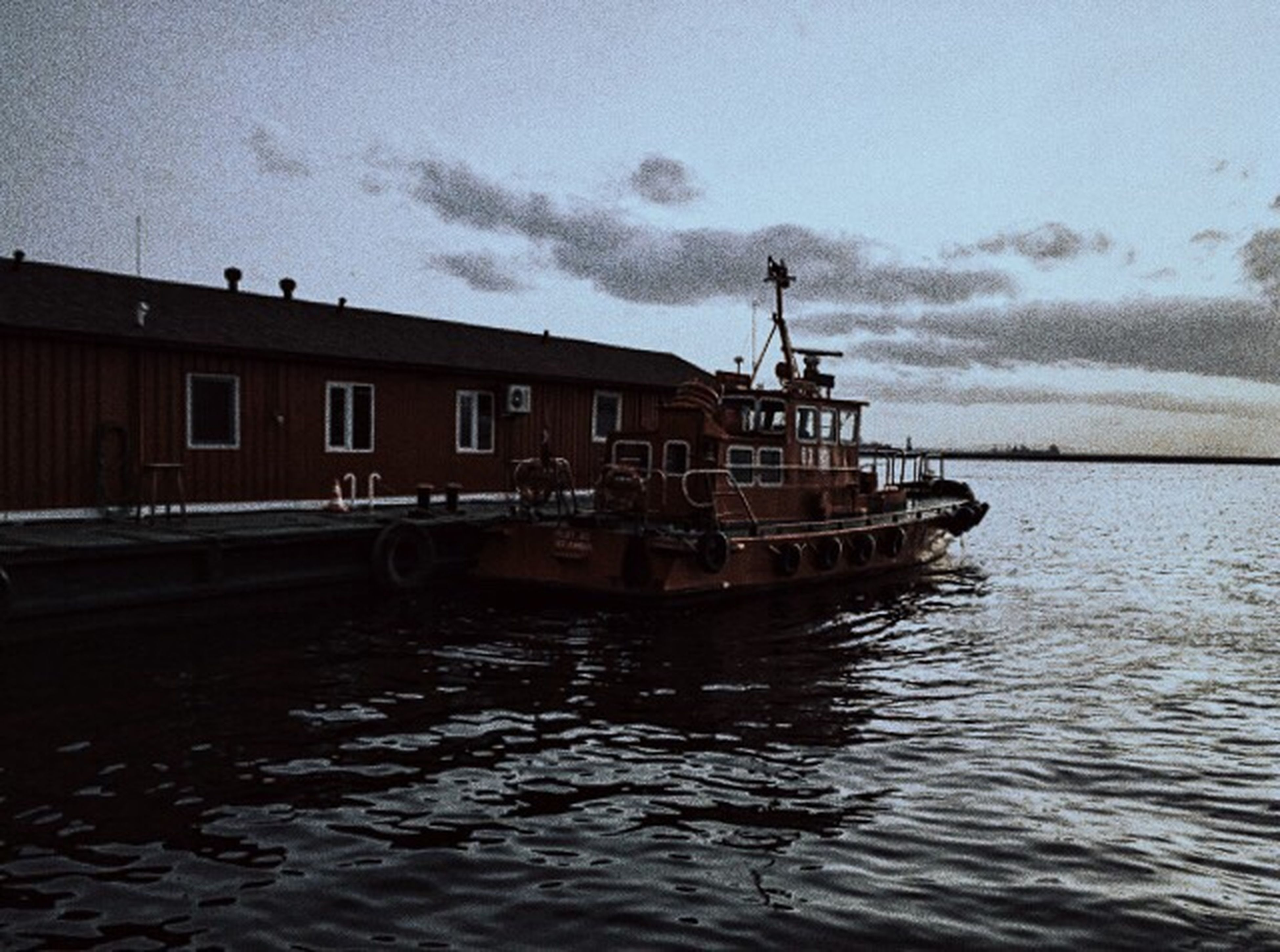 architecture, water, built structure, sky, waterfront, cloud - sky, rippled, city, outdoors, building, cloud, day, cloudy, nature, no people, canal, overcast, travel destinations, weather, city life