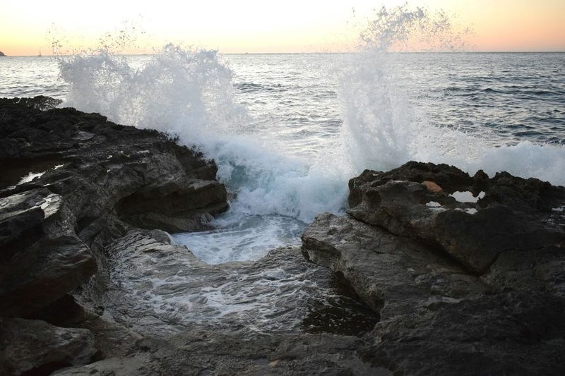 Sea Wave Sunset Beauty In Nature Nature Water Horizon Over Water Motion Power In Nature No People Breaking Rock - Object Beach Sky Outdoors Crash Scenics Day The Week On EyeEm