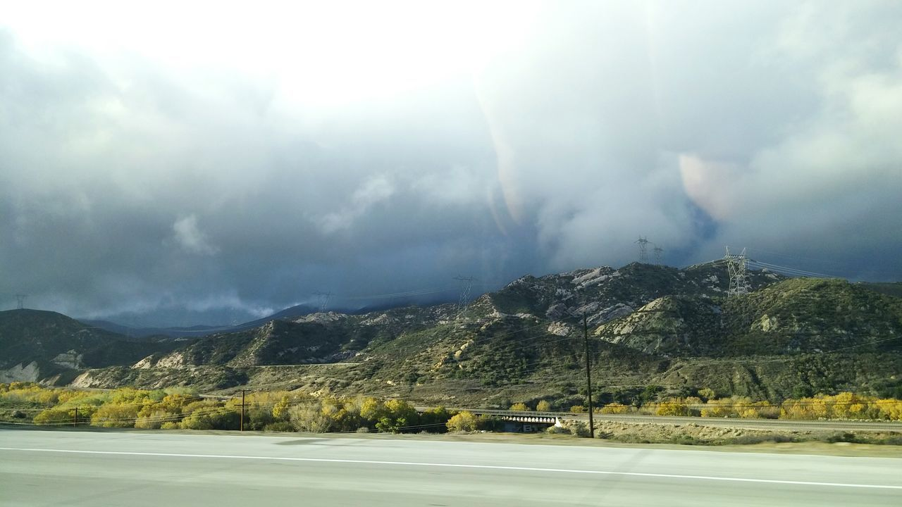 Moving Shot Mountains And Sky Dark Clouds Highway Driving Travel The Artsy Lens Mobile Photography LG G3 Photography Ladyphotographerofthemonth The Great Outdoors With Adobe The Great Outdoors - 2016 EyeEm Awards