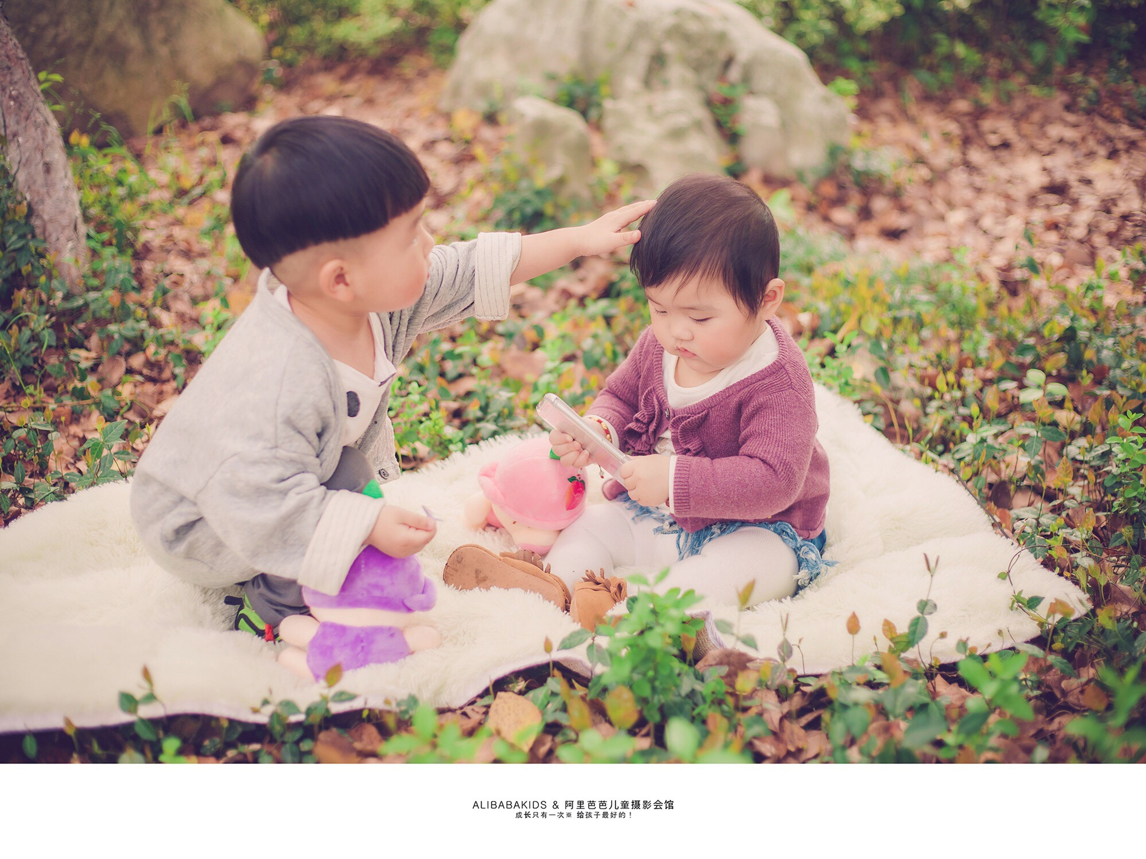 lifestyles, leisure activity, childhood, person, casual clothing, togetherness, elementary age, boys, bonding, holding, love, innocence, cute, sitting, standing, high angle view, field