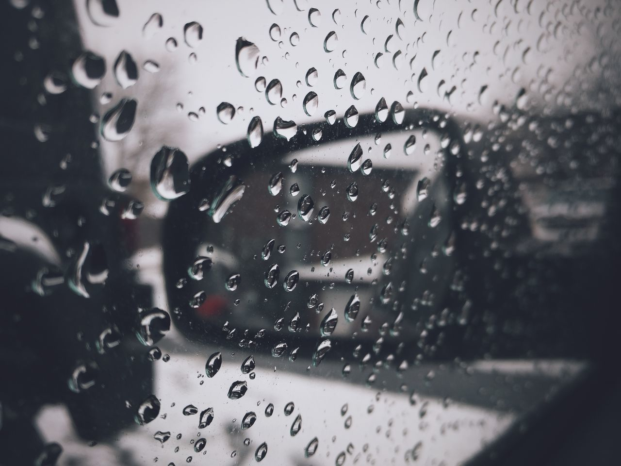 glass - material, window, transportation, drop, wet, water, transparent, rain, mode of transport, weather, vehicle interior, focus on foreground, windshield, land vehicle, no people, car, looking through window, close-up, day, airplane, sky, indoors, raindrop, airplane wing