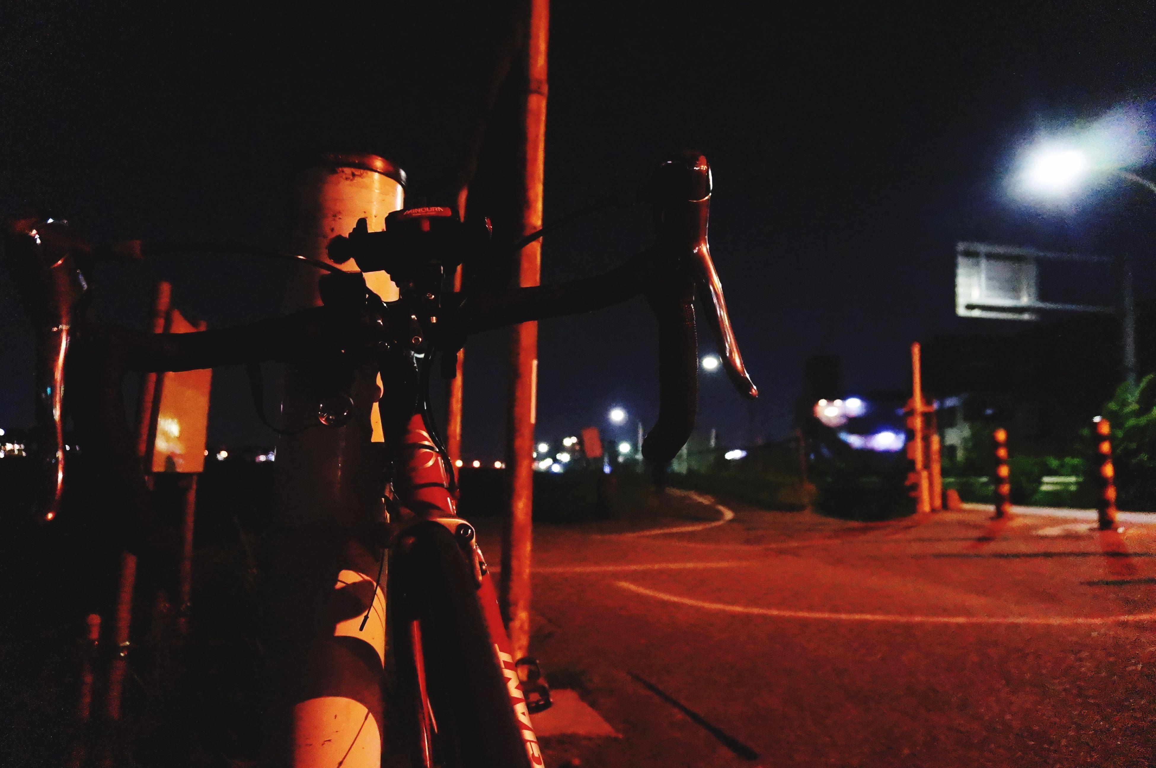 illuminated, night, street light, lighting equipment, men, lifestyles, street, leisure activity, person, light - natural phenomenon, transportation, outdoors, incidental people, dark, unrecognizable person, standing, rear view, medium group of people