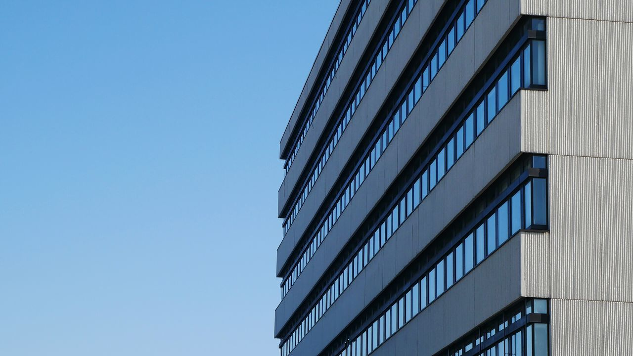 low angle view, architecture, built structure, building exterior, day, copy space, clear sky, outdoors, no people, blue, modern, sky