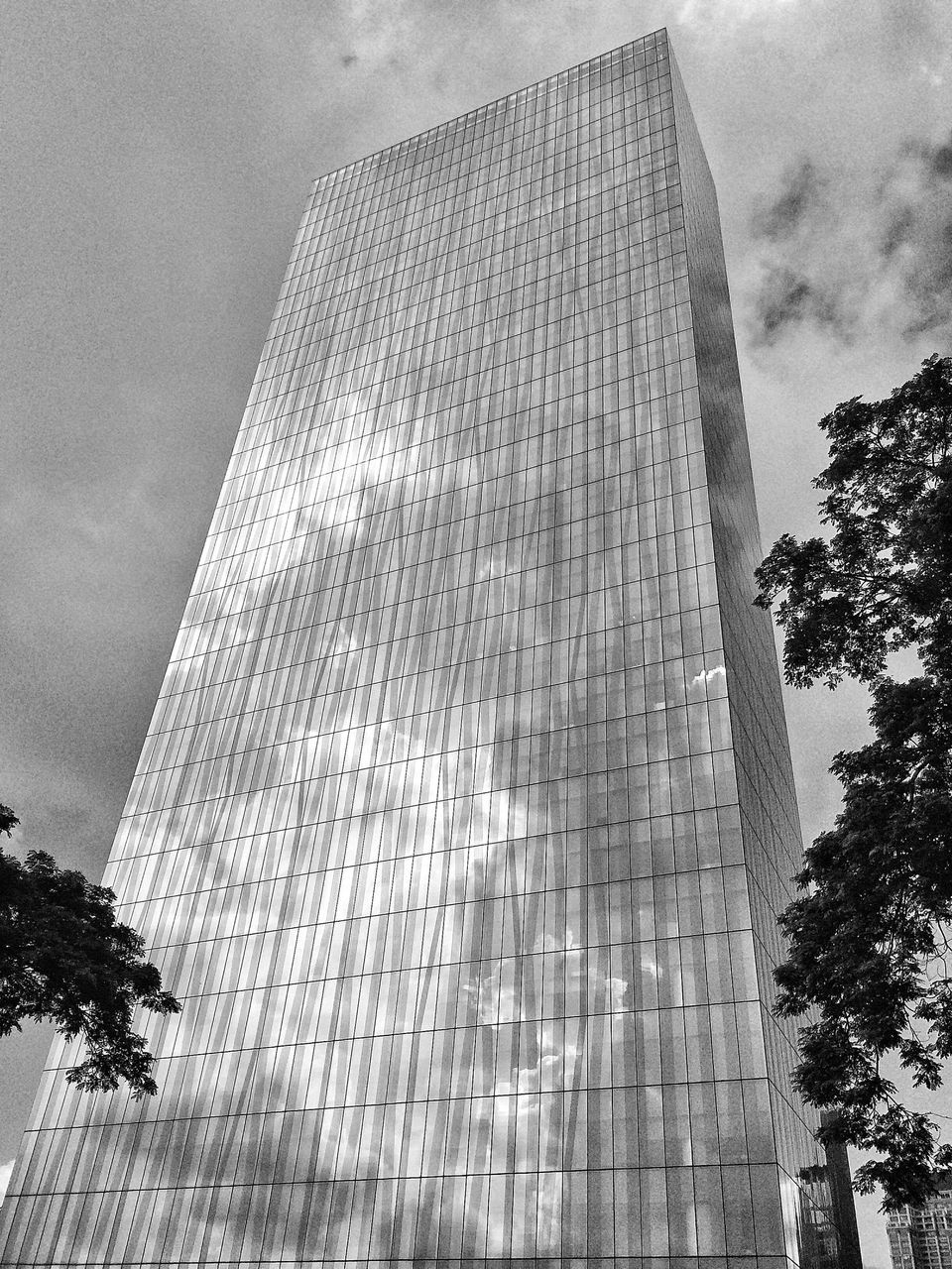 architecture, low angle view, built structure, sky, tall - high, building exterior, tree, skyscraper, day, history, outdoors, modern, cloud - sky, travel destinations, no people, city, pyramid