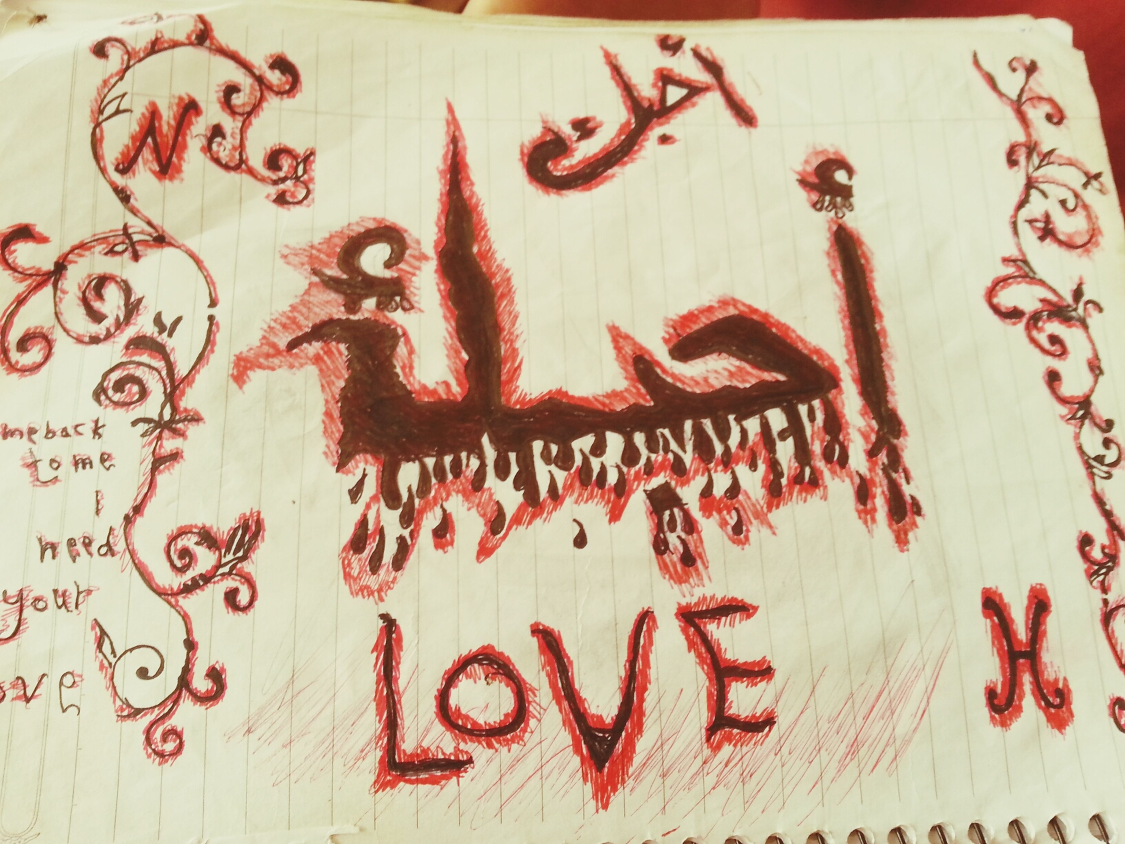 text, creativity, indoors, western script, art, art and craft, communication, red, close-up, wall - building feature, heart shape, love, paper, graffiti, wall, animal representation, ideas, no people, still life, design