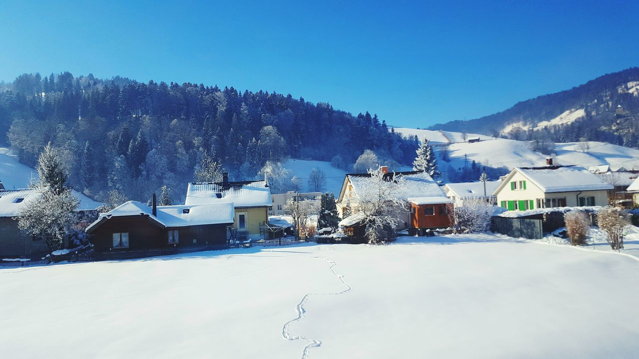 snow, winter, house, cold temperature, built structure, mountain, architecture, building exterior, mountain range, scenics, nature, tranquility, no people, residential building, day, outdoors, tranquil scene, blue, tree, clear sky, beauty in nature, landscape, sky, snowcapped mountain