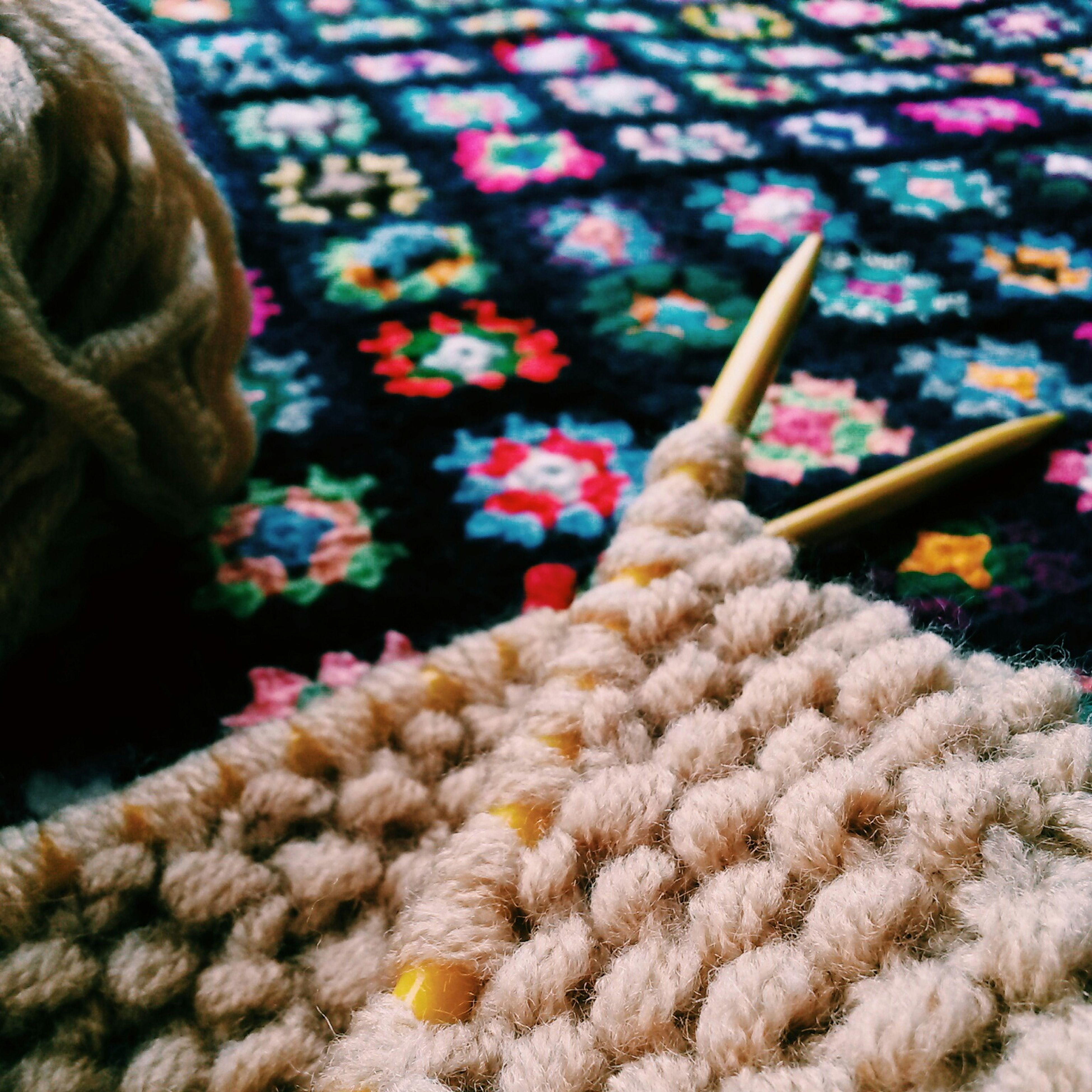 indoors, close-up, still life, focus on foreground, abundance, selective focus, wool, pattern, textile, multi colored, fabric, large group of objects, no people, art and craft, rope, part of, feather, high angle view, detail, retail