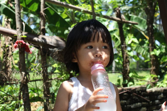 Asian Children Bottle Everyday Emotion Eye4photography  Indonesia_photography Kids Being Kids Kidsphotography My Daughter Portrait Portraits Shadows & Lights Taking Photos
