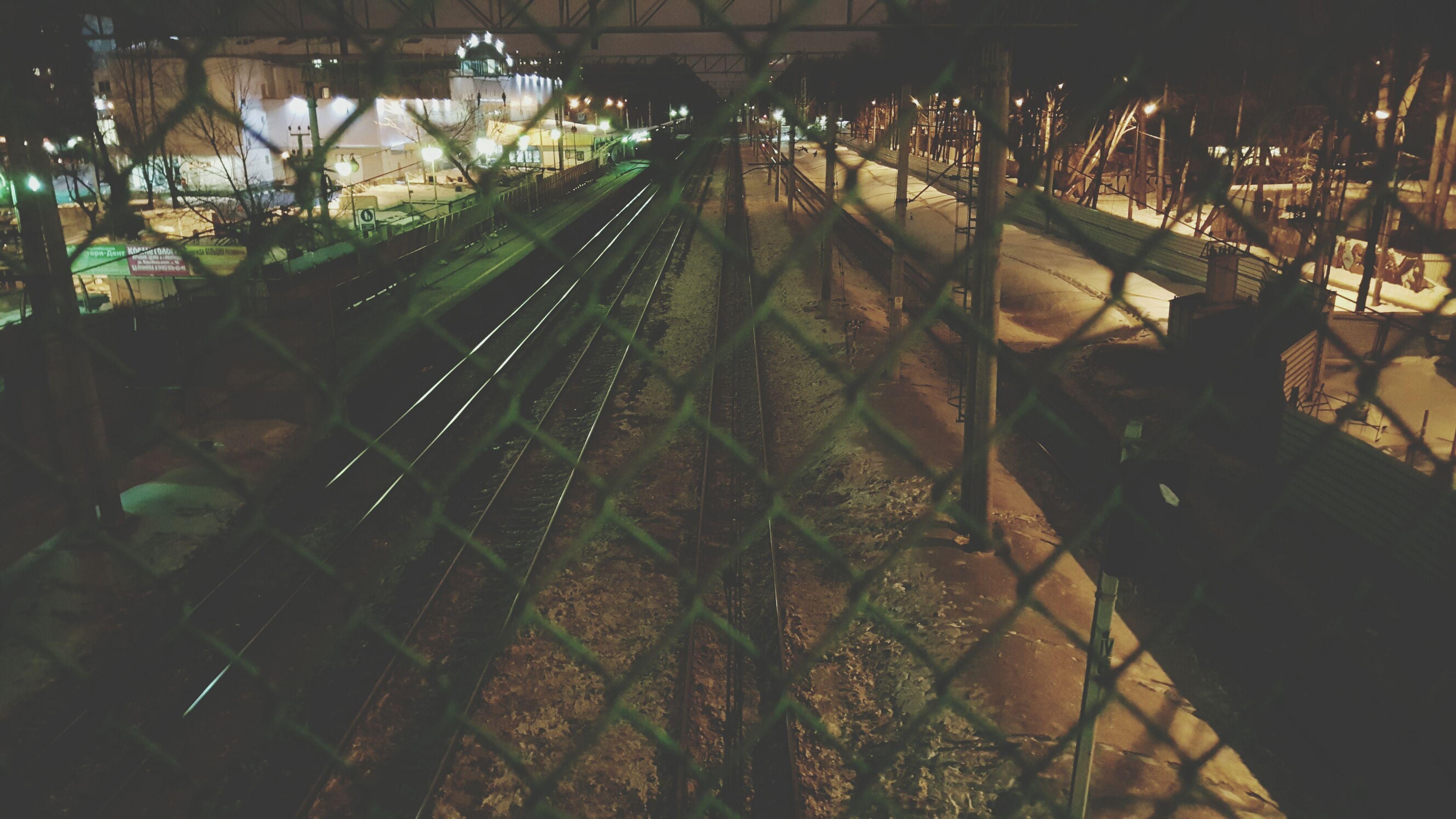 high angle view, railroad track, transportation, rail transportation, travel, tree, no people, night, public transportation, outdoors