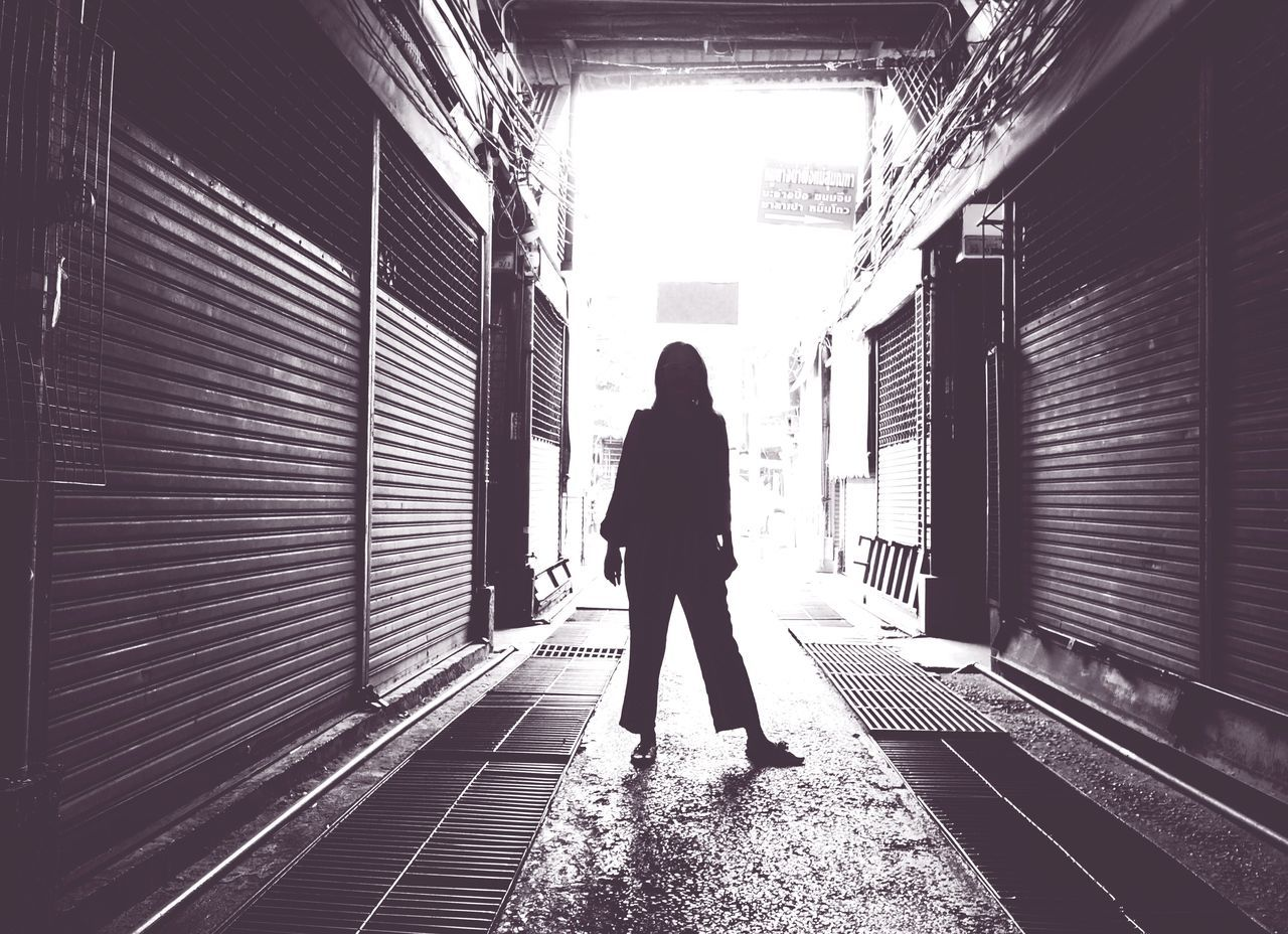 An alleyway, lane One Person Full Length Rear View Real People Women Standing Day Indoors  Only Women One Woman Only Architecture Adult Young Women One Young Woman Only Young Adult People Adults Only